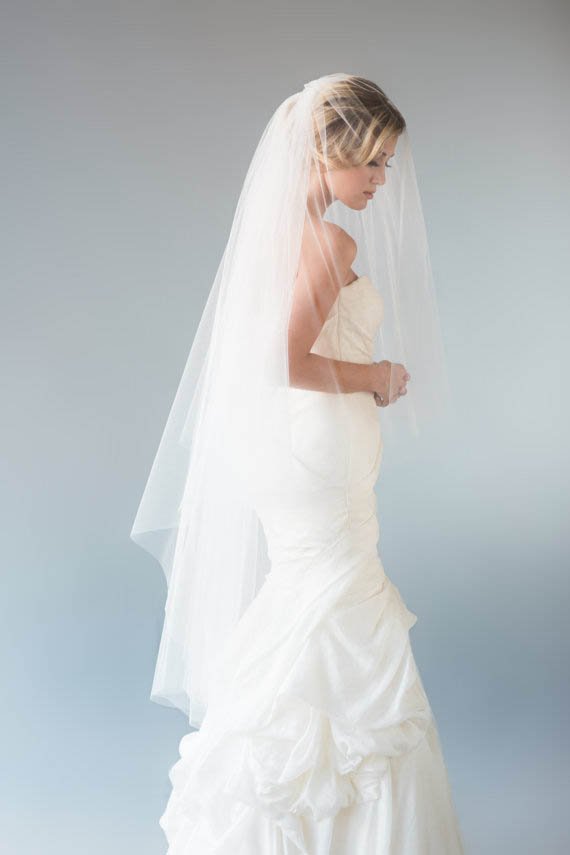 This waltz length veil is long but doesn't quite touch the floor.