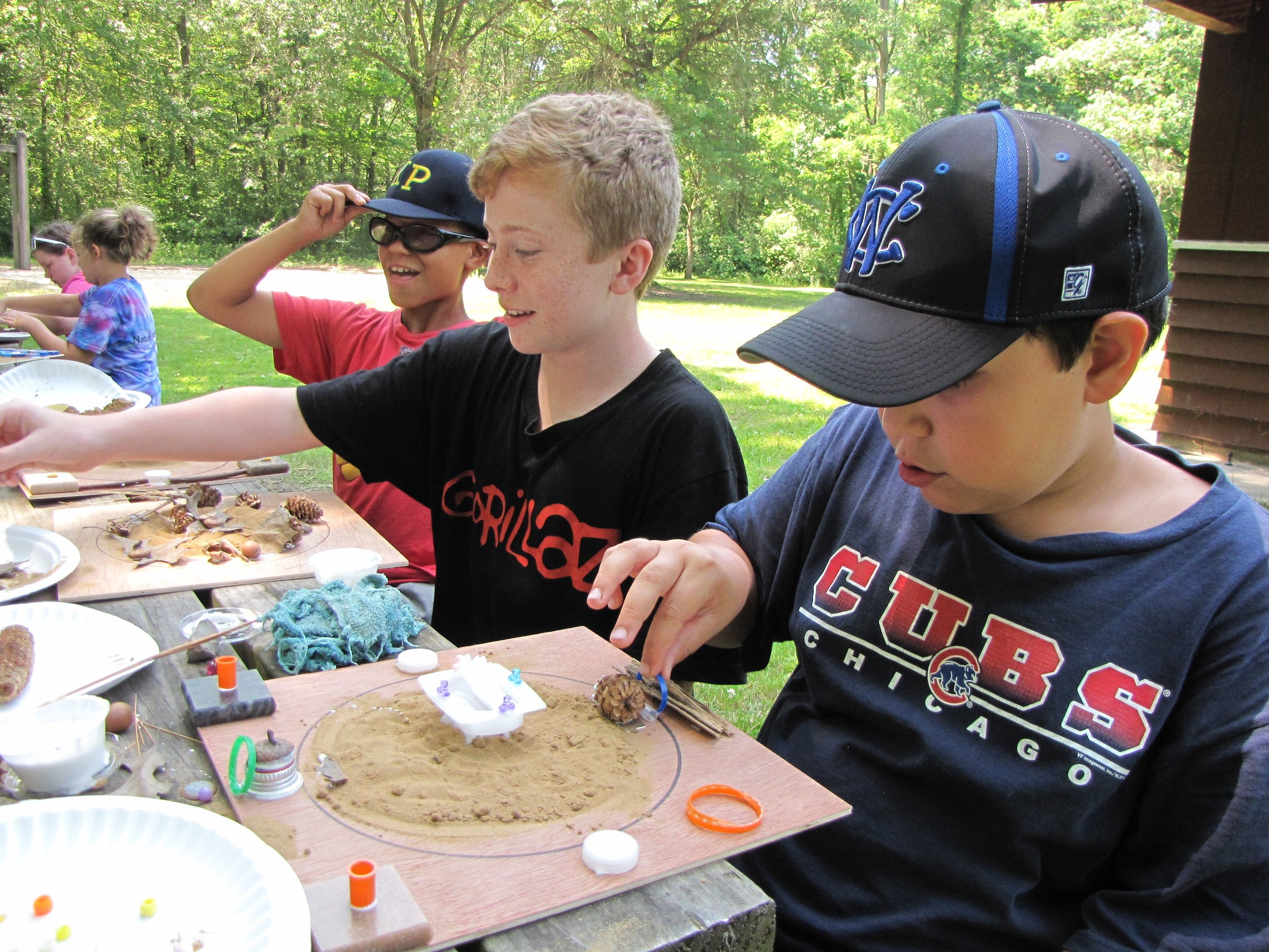 """Campers share inspiration and suggestions while working """"en plein air""""."""