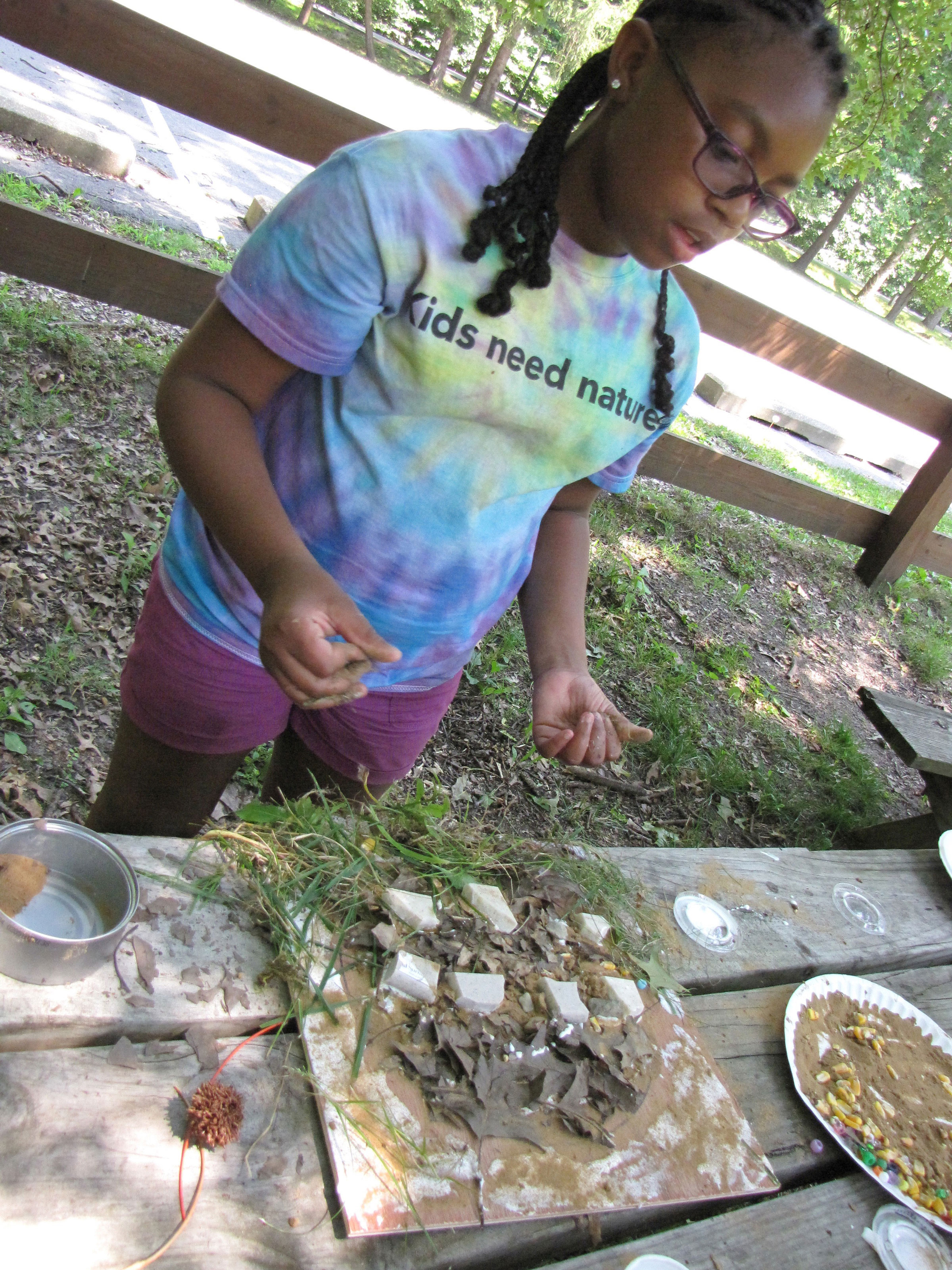 A camper explains the ecosystems represented in her composition.