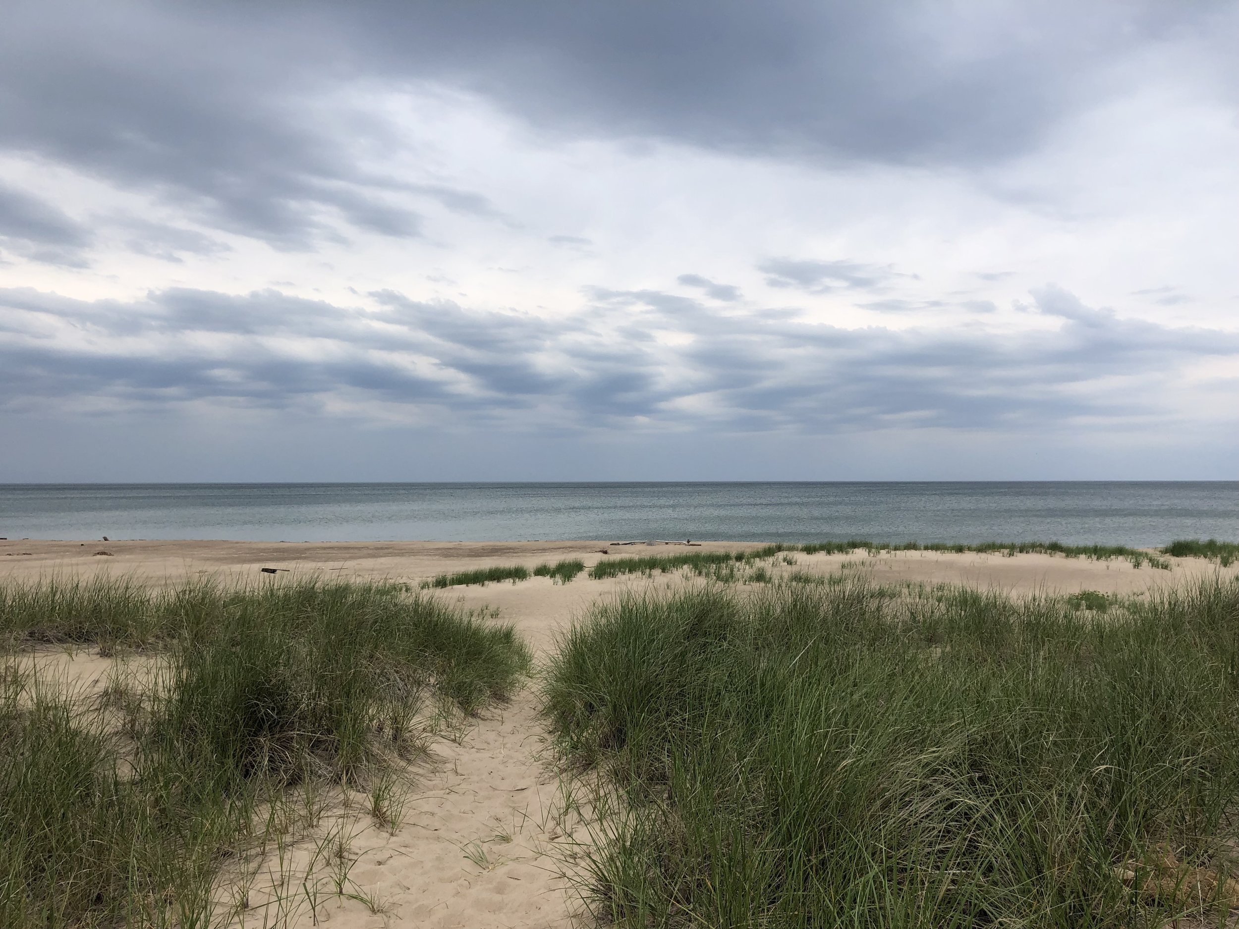 Sand, dune grass, Lake Michigan with clouds