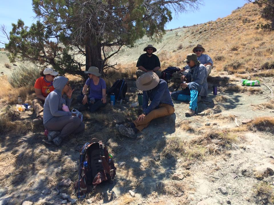 The paleo group taking a lunch break under the shade of a juniper tree. Photo courtesy of Win McLaughlin.
