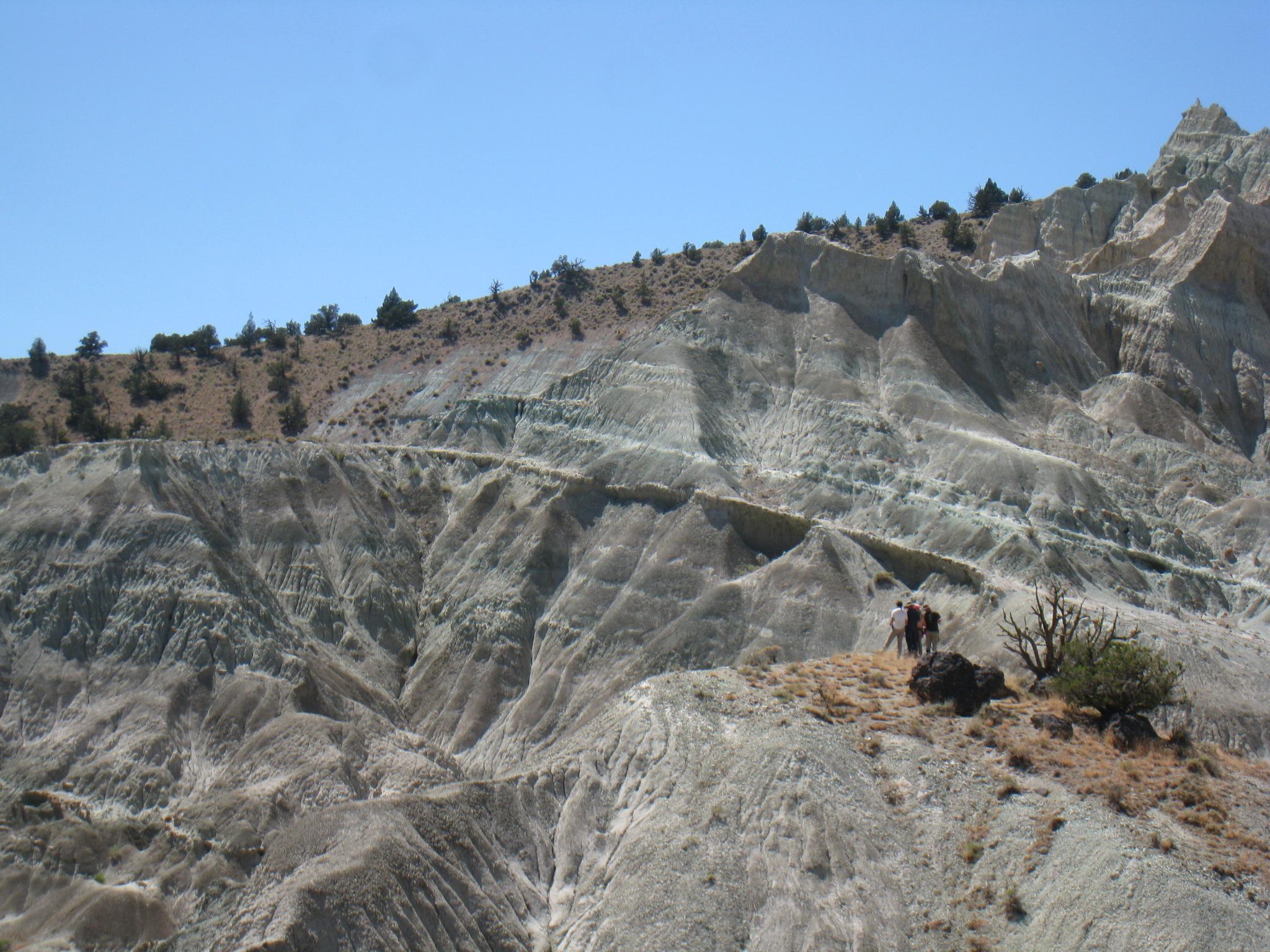 Students surveying Logan Butte.