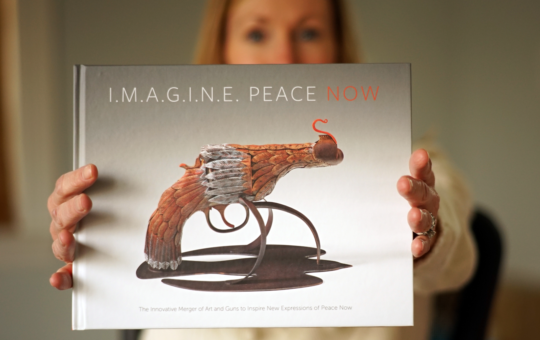 imagine_peace_now_holding_book.png