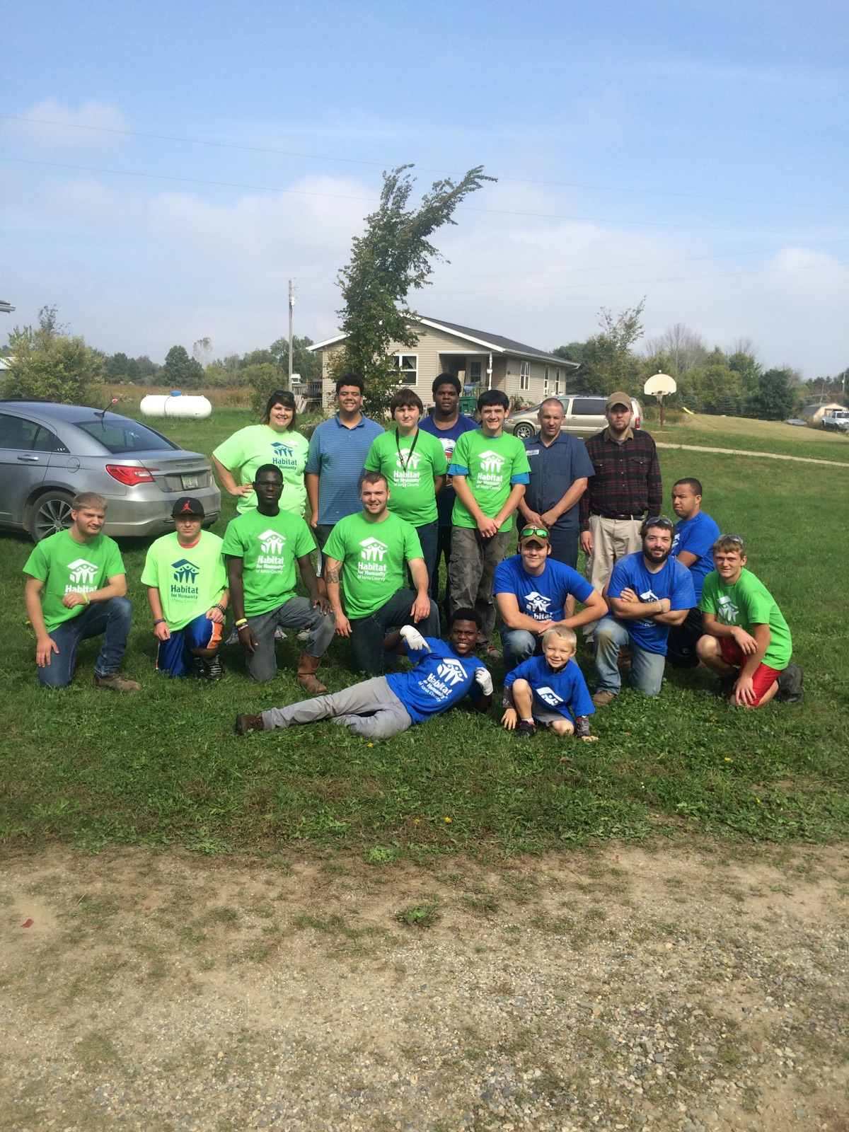 Ranchers and Staff Volunteer at Habitat for Humanity