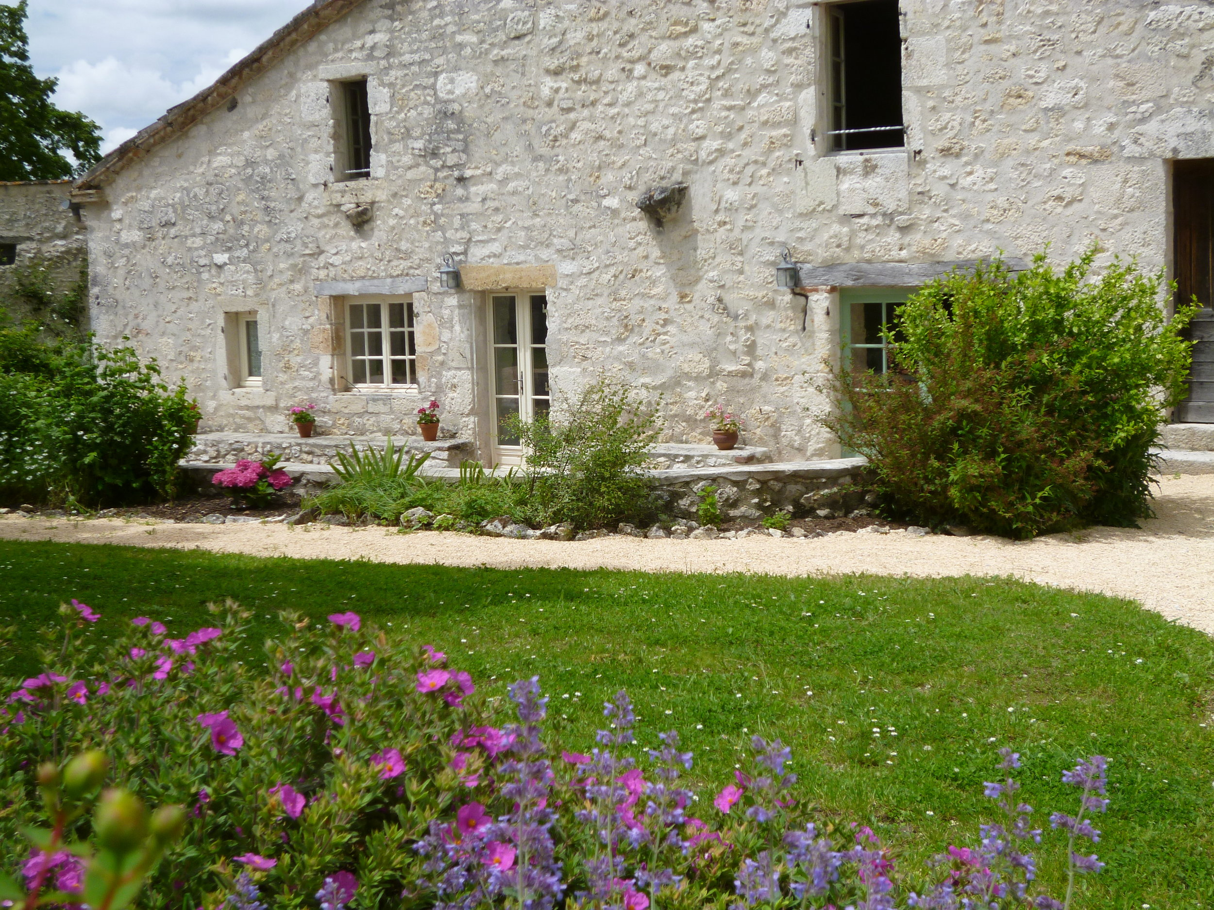 I love this picture, but as you can see the shutters have not yet been put back after painting. They are back on now!
