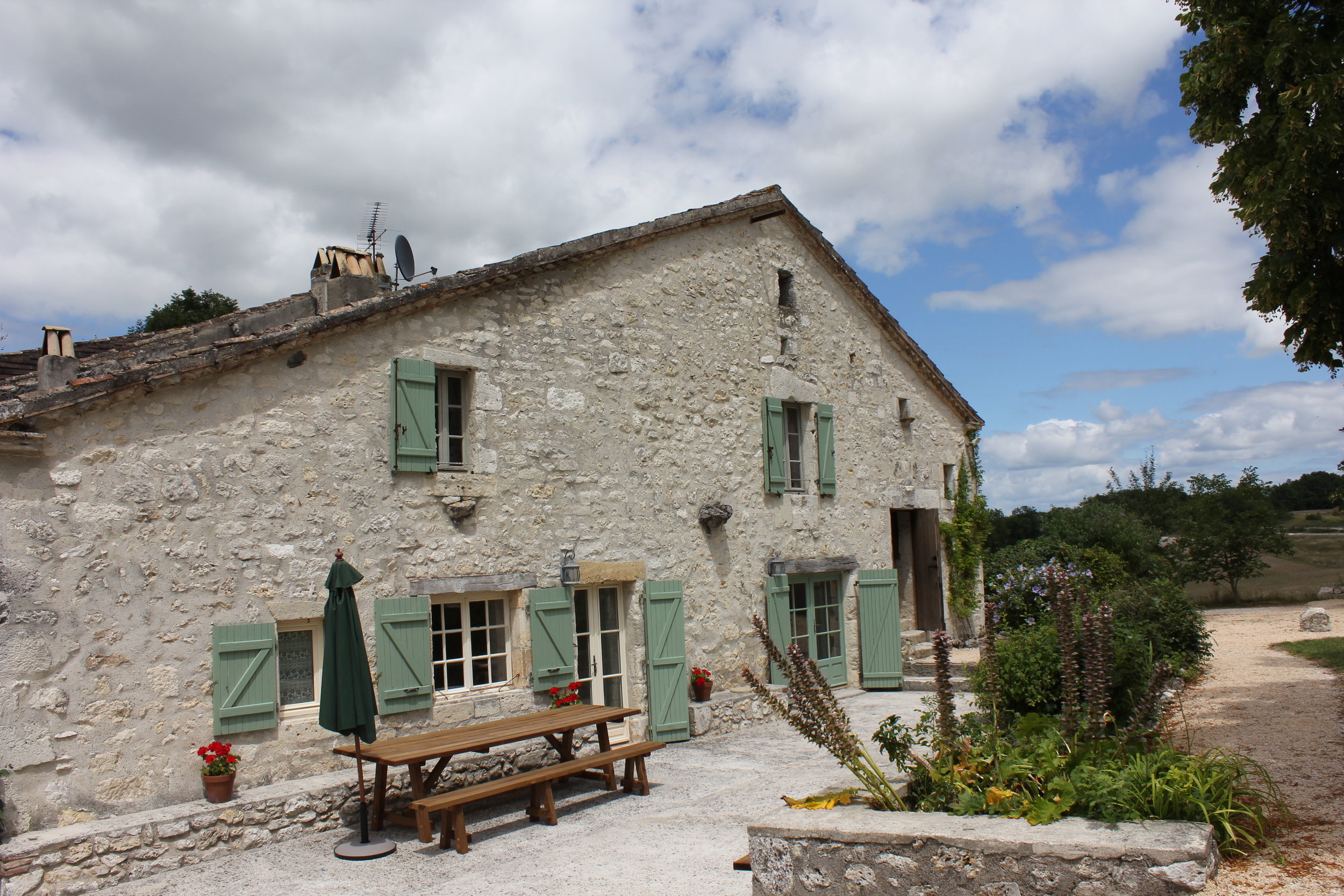 The French Farmhouse with new outside table & benches.