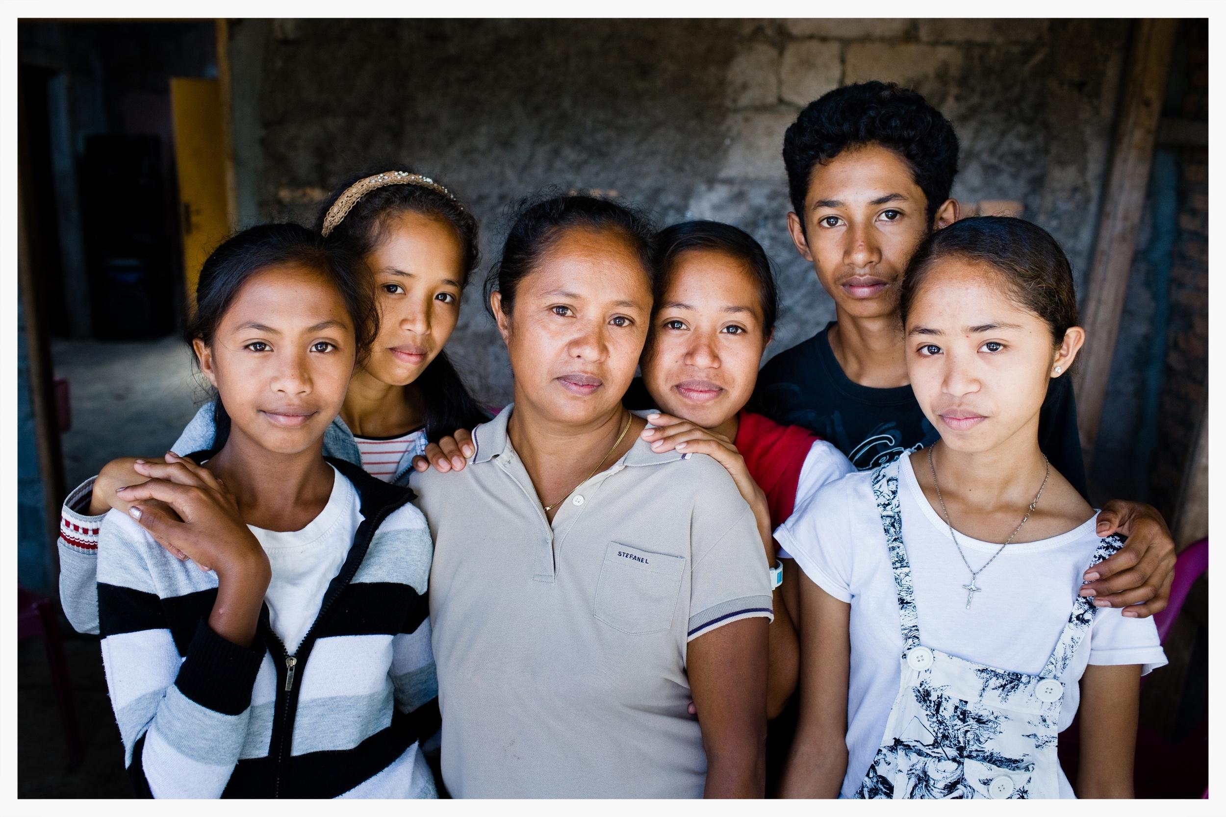 Jelia Boavida de Jesus at home with her children.East Timor.Photo: © Marcus Perkins