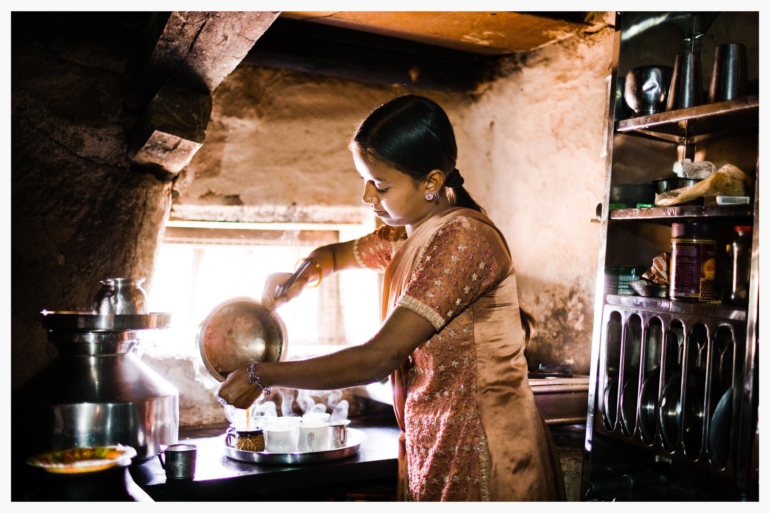 Jaya, sister of Sanju, carefully prepares chai at home for us.