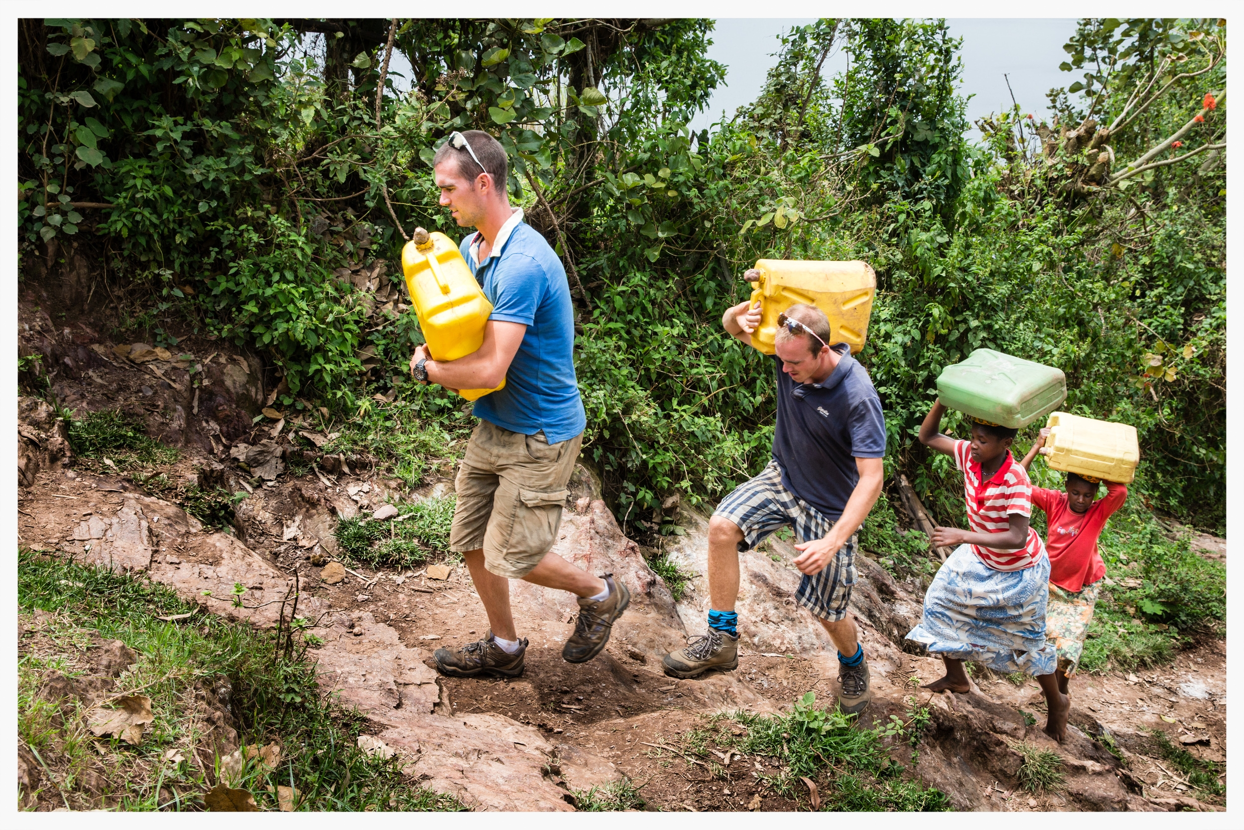 Richard and Peter Chambers join Doreen and Jouvllet on their daily trek to collect water. Despite the athletes' fitness, they admitted the walk had been far tougher than expected. Kabale district, southwest Uganda. Photo © Marcus Perkins