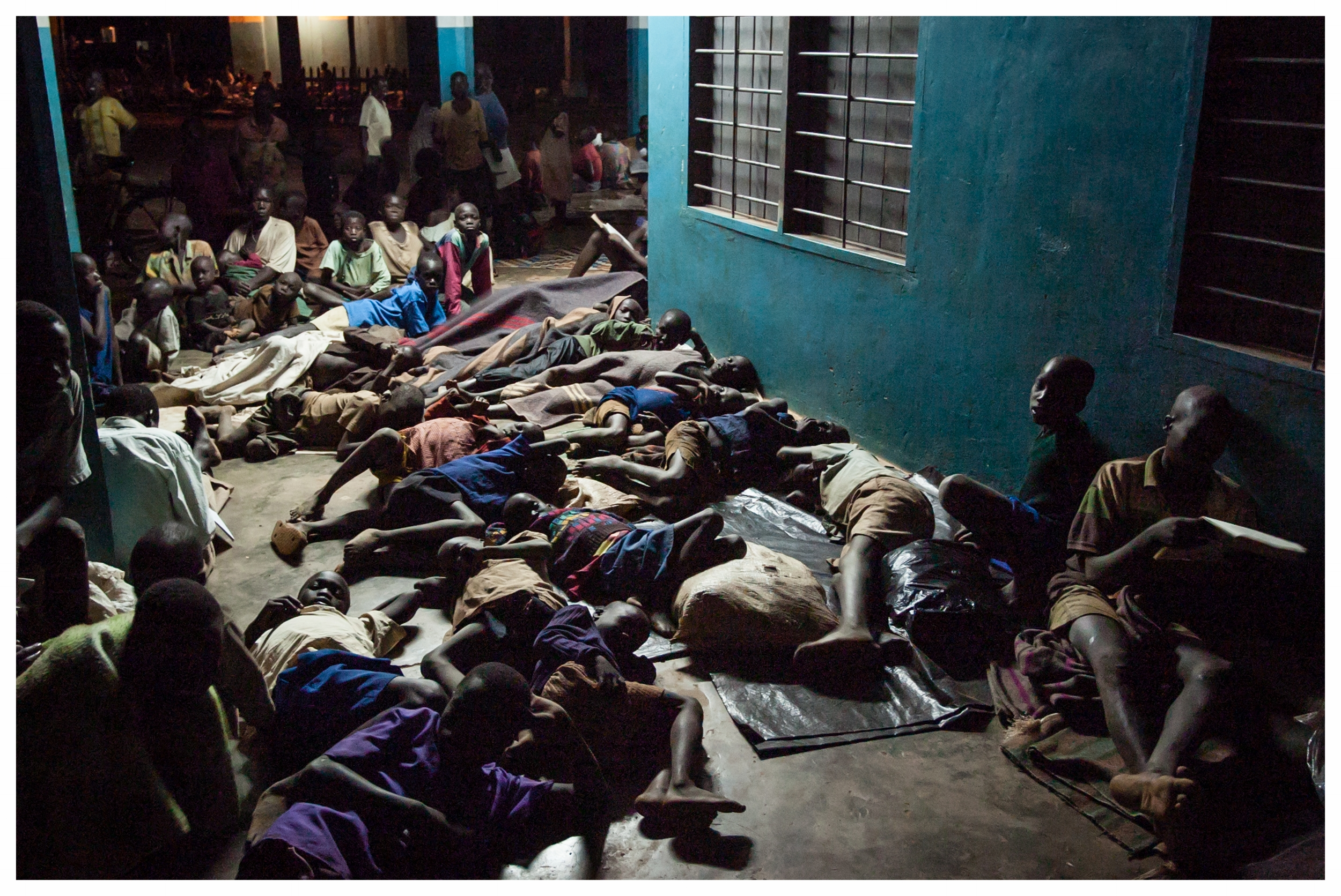 Children sleep rough wherever they can find shelter. Gulu, Northern Uganda. Photo © Marcus Perkins