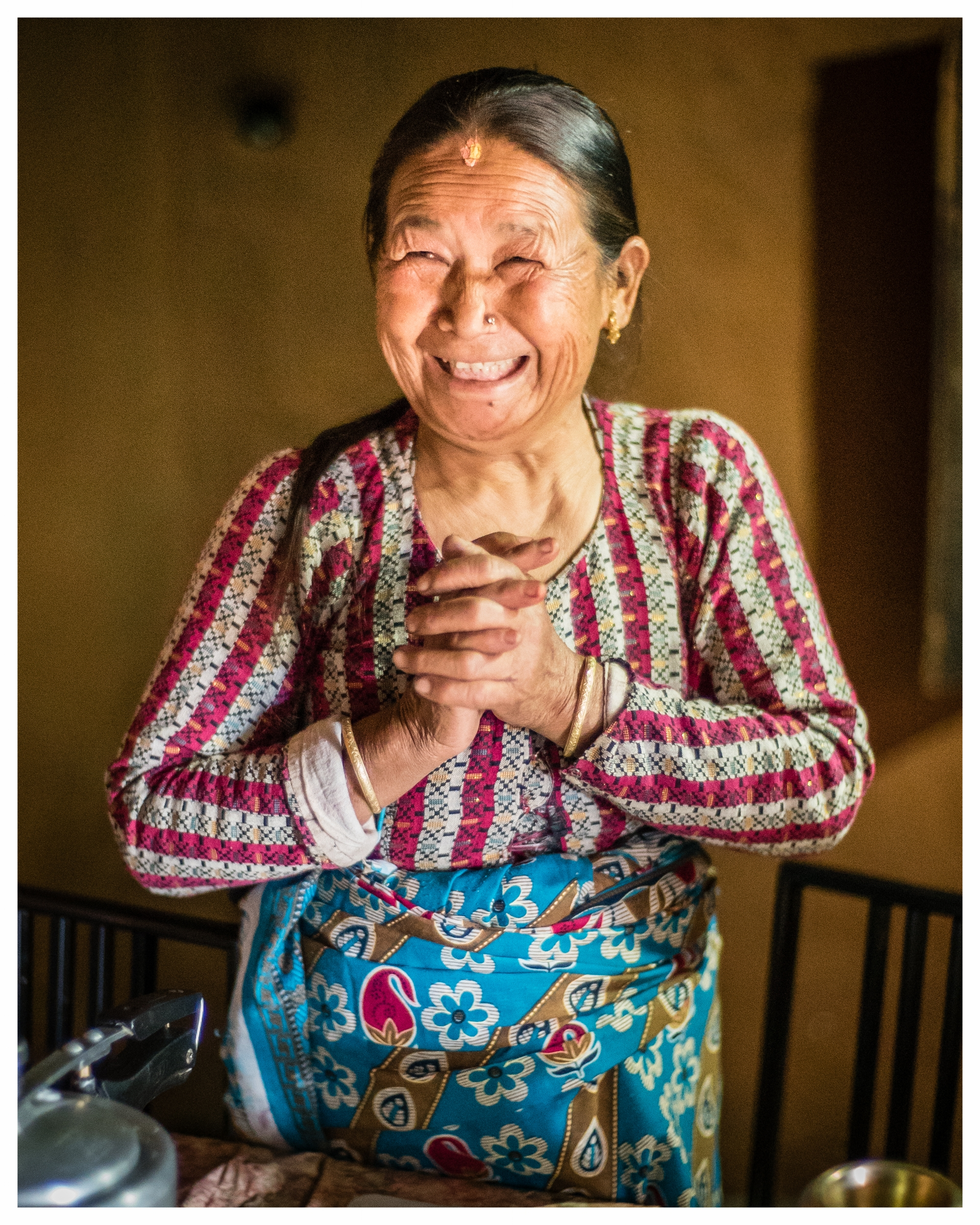 Bhagwati Thapa, who suffers with lymphatic filariasis, invites us to join her for tea. Bungmati, Nepal. Photo © Marcus Perkins