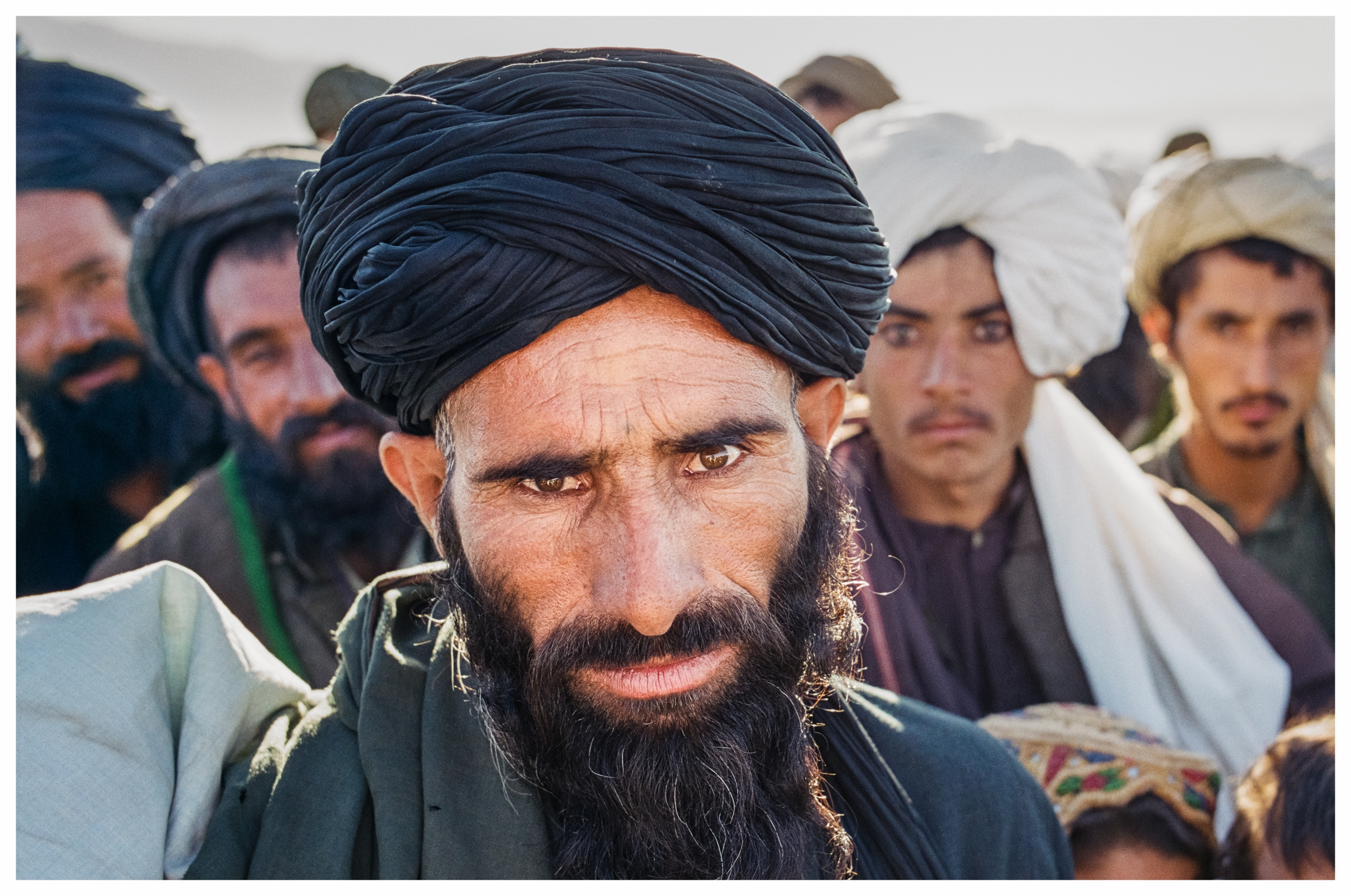 Afghans always study foreigners with an intense curiosity, but behind the piercing eyes you'll often find a warm welcome. Photo © Marcus Perkins