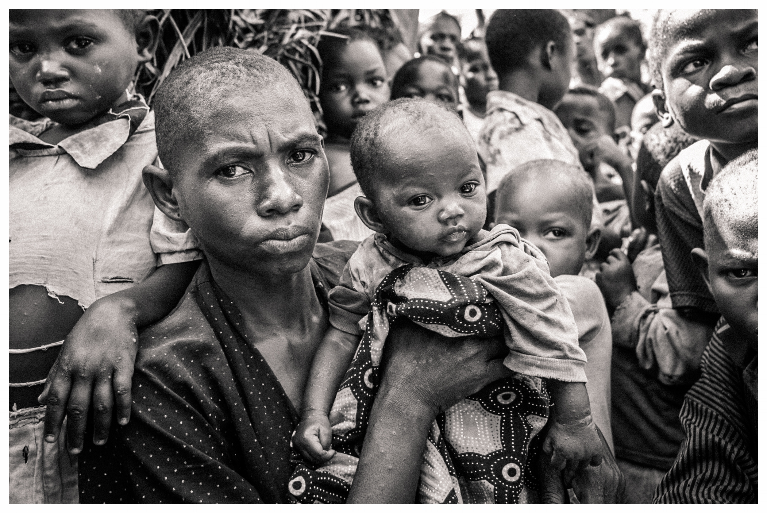 Displaced mother and child following atrocities in north east Congo. Photo © Marcus Perkins
