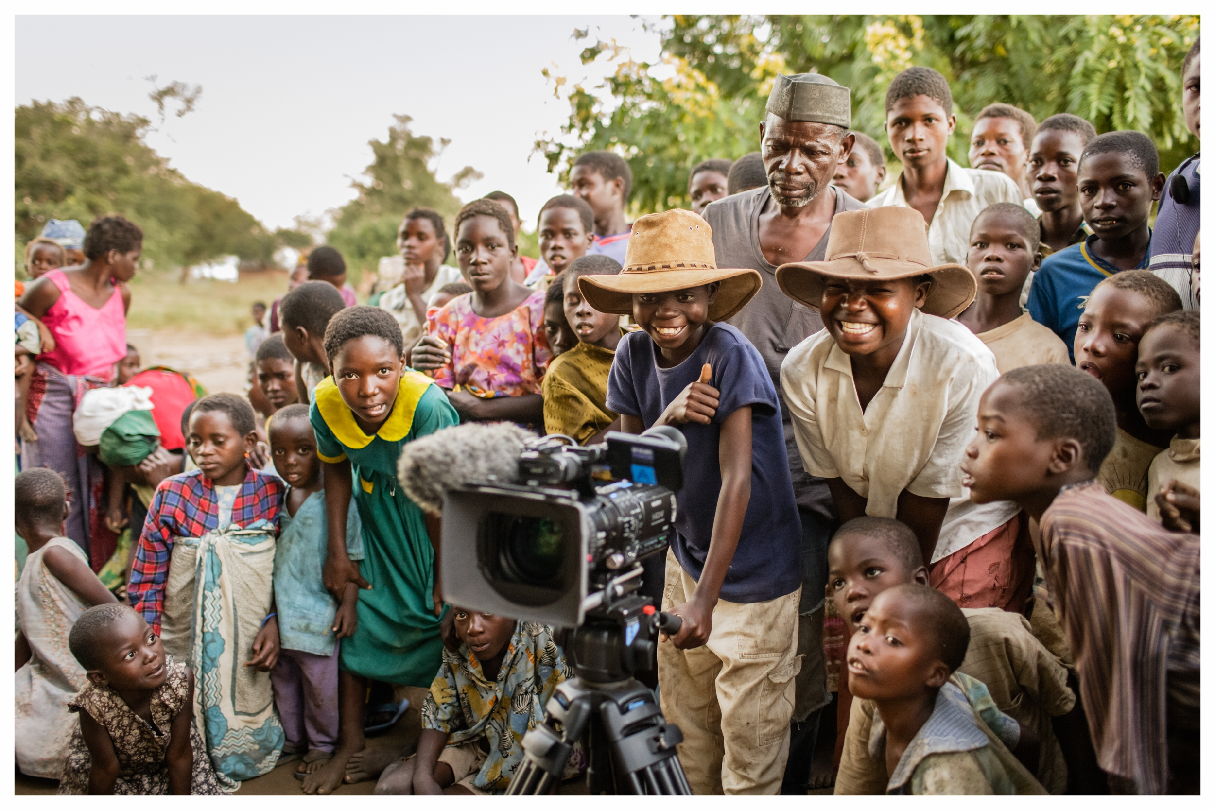 Children direct and shoot a short movie in Fombe Village. Chikwawa, Malawi. Photo © Marcus Perkins