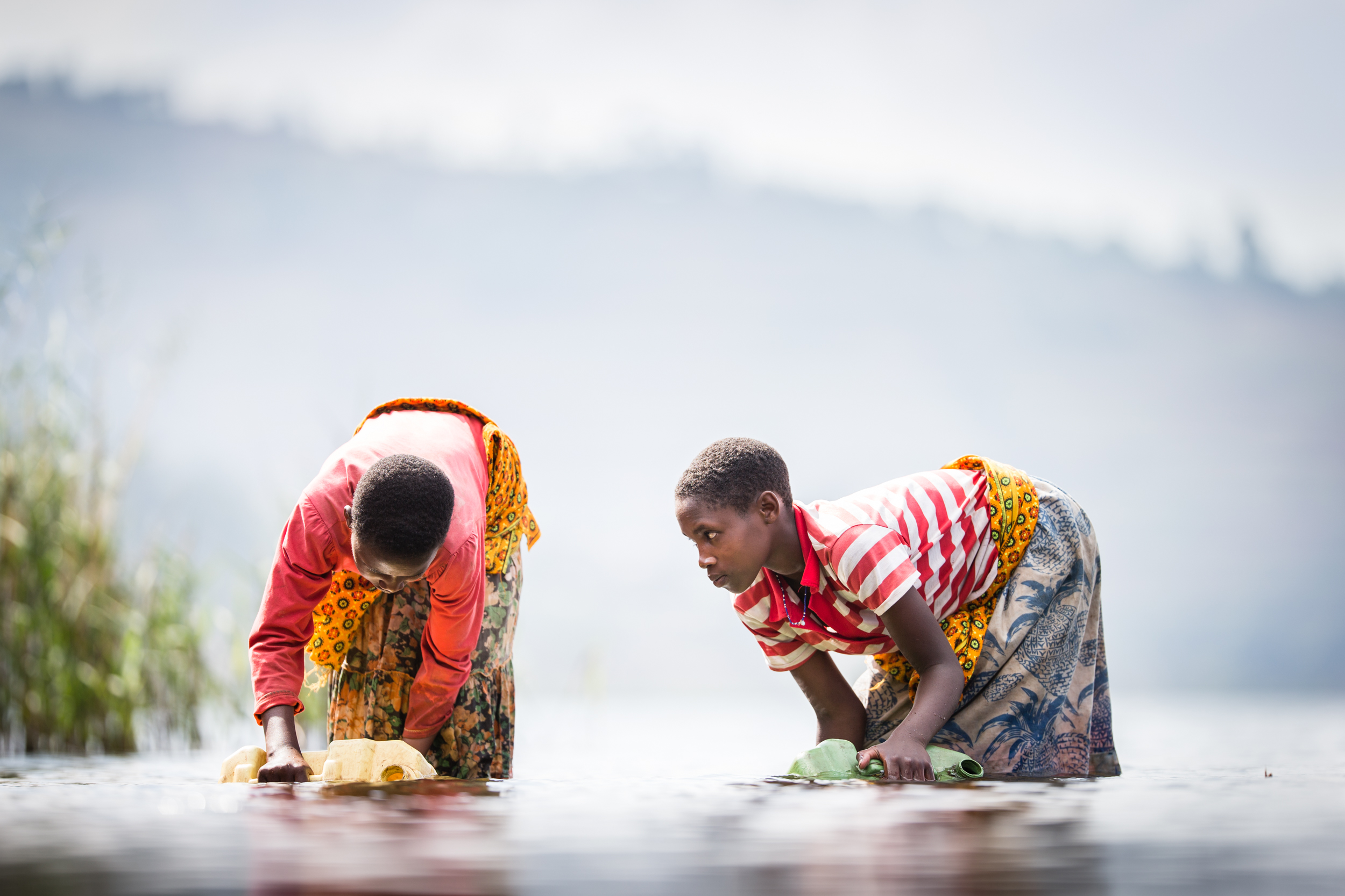 An Olympic challenge - Olympic rowers, Richard and Peter Chambers, learn about the challenges facing many children responsible for collecting water in south west Uganda.