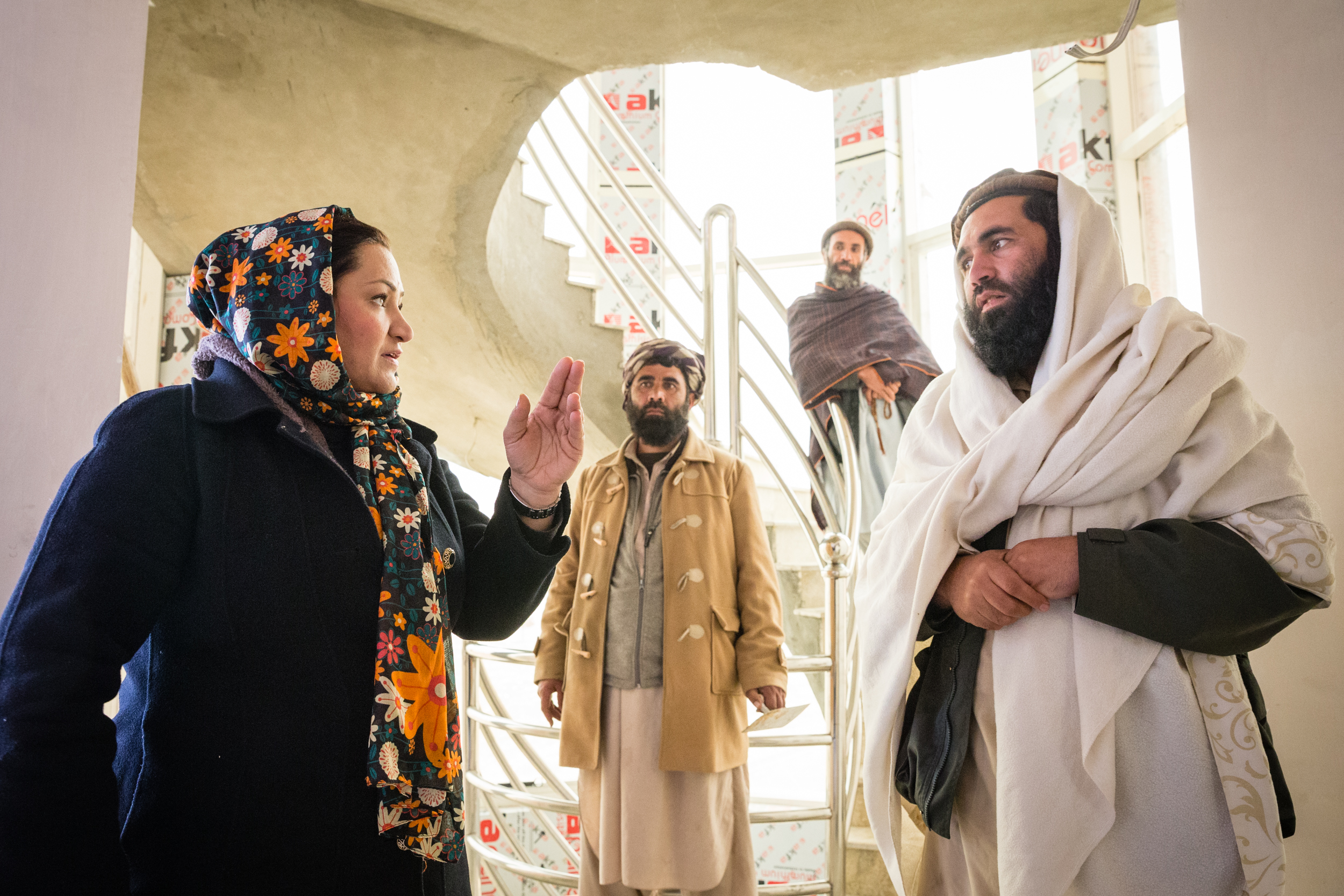 Civil engineer Manizha Paktin (left), director and co-founder of Stand Up for Afghan Women, instructs builders at a construction site in Kabul.  Manizha was one of seven people photographed for an Amnesty International report to highlight women human rights defenders at risk in Afghanistan.