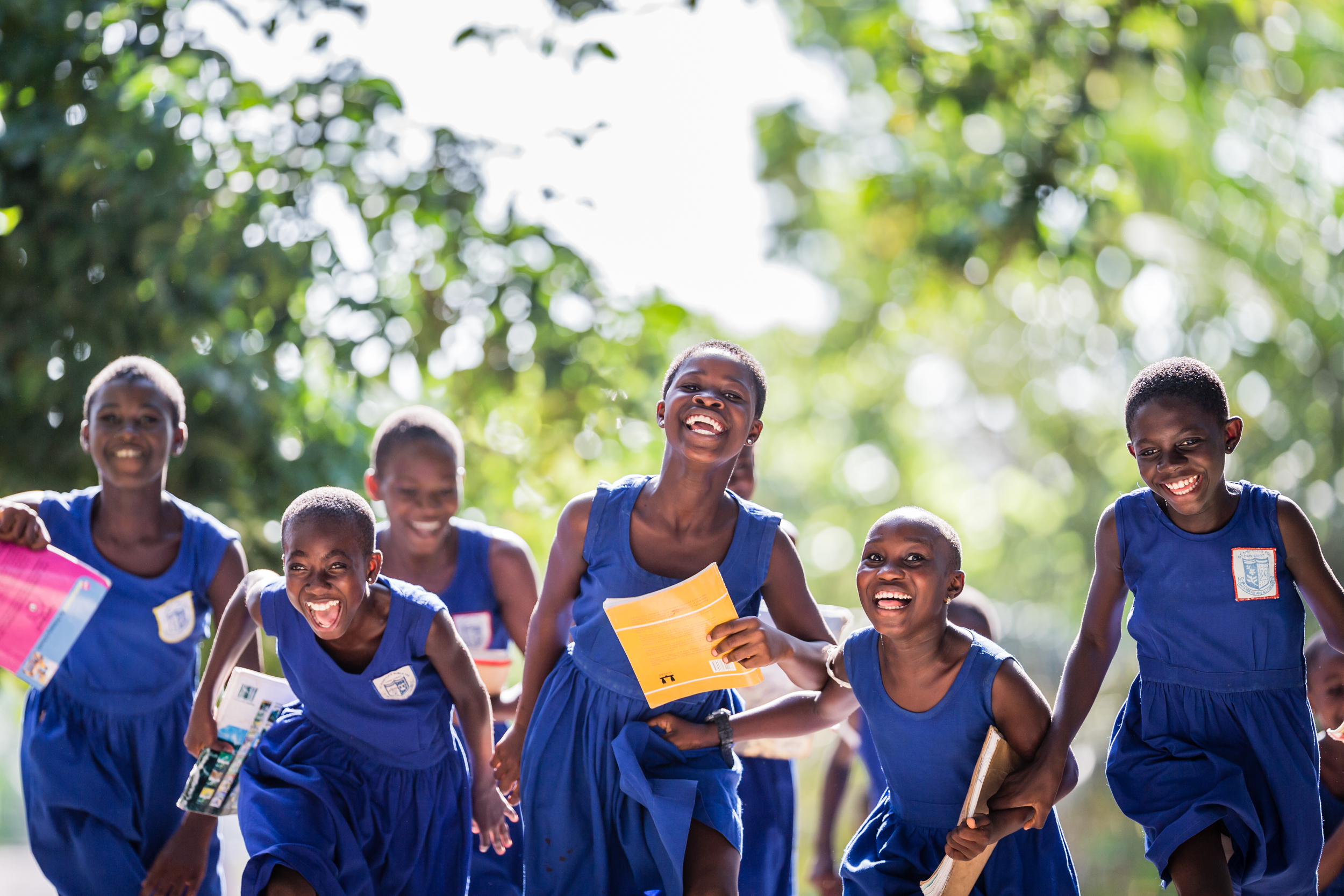 Roundworms, whipworms, hookworms and other soil-transmitted helminths have failed to put the brakes on these excited children, running to their after-school learning club at St Monica's Girls School. Thanks to the ongoing deworming programme in their community, these girls can keep on running towards empowerment and education. Cape Coast, Ghana.  Commissioned by GSK to illustrate the global campaign by the World Health Organisation (WHO)to combat intestinal worms in school-age children.WHO estimates that over 600 million school-age children are living in areas where these parasites are transmitted.