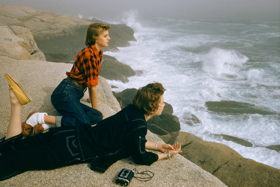 Two women gaze at heavy surf while lying on boulders on the coast of Nova Scotia, December 1961.Photograph by Volkmar Wentzel, National Geographic