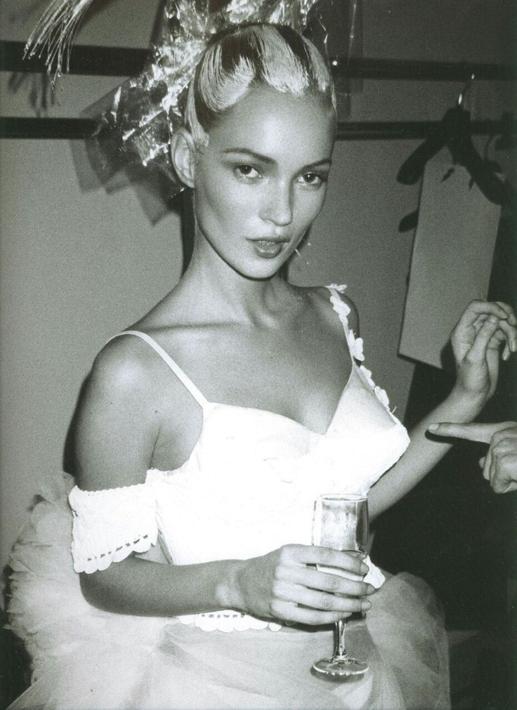 Kate Moss  backstage at the  John Galliano   Spring 1996  show. Photographed by  Mario Testino .