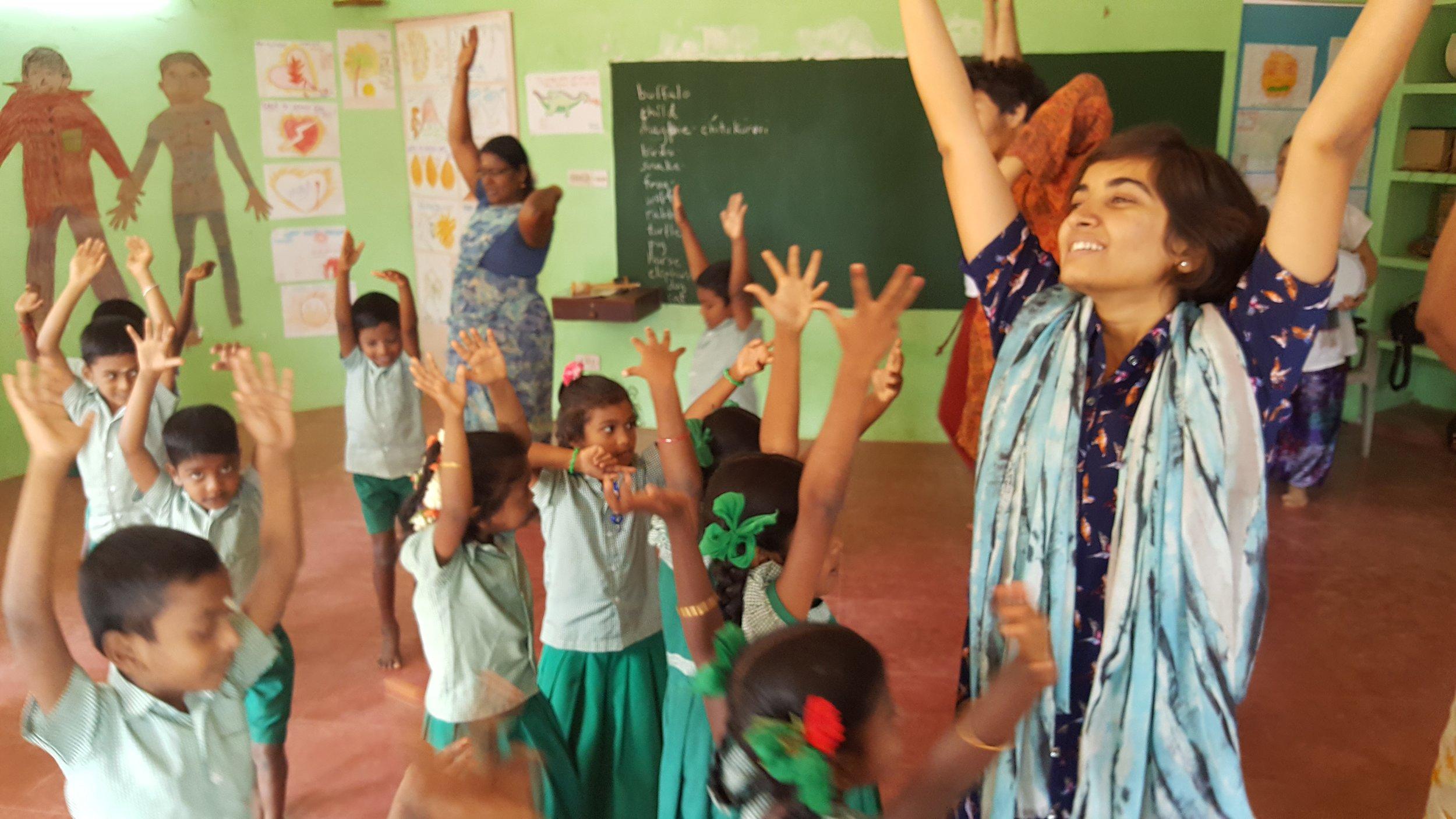 Teacher, Usha, working with the students at Akiyam School.