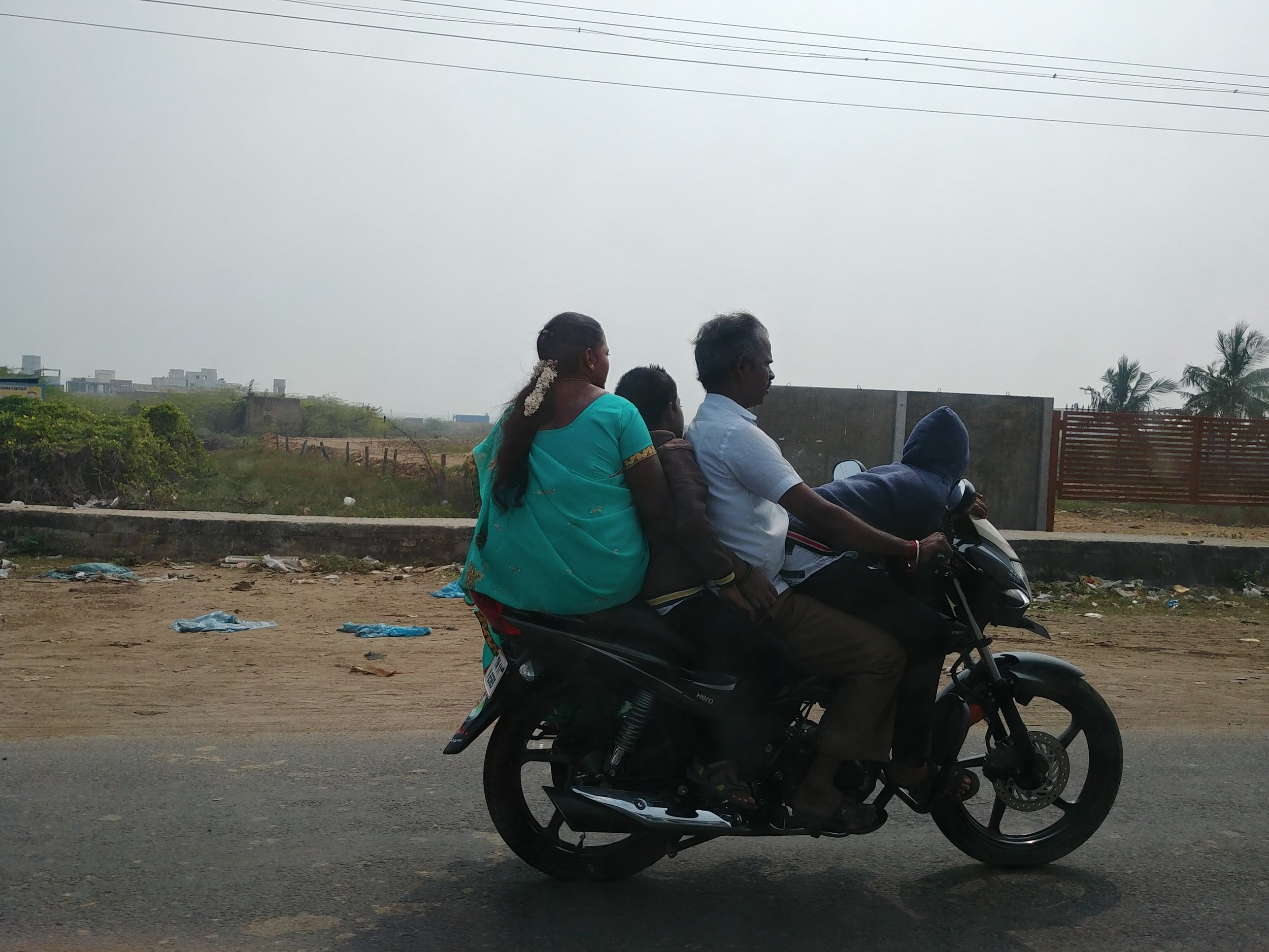 """""""Feels so natural to be back in India. Many families of 4 on a bike. No helmets...yikes!"""" - Livia"""