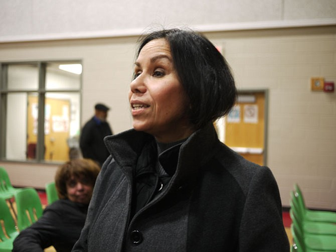 Raquel Page talks after the January meeting about Fire Station #8. Photo by Eden Brown/Gazette Packet