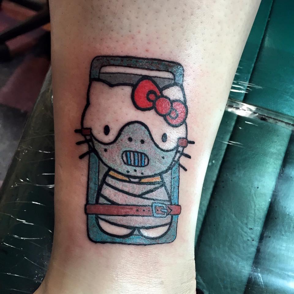hannibal kitty tattoo.jpg