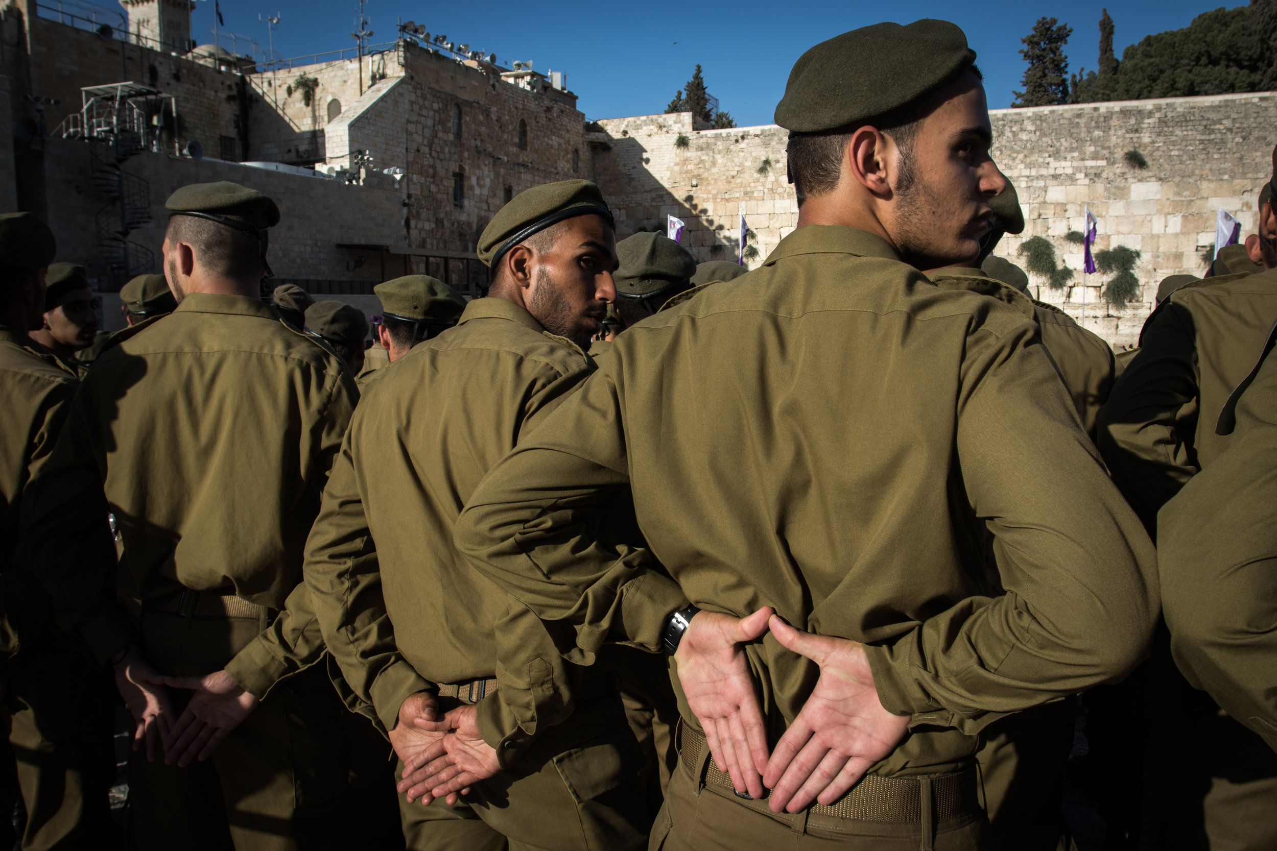 New soldiers of the Giv'ati combat brigade stand at attention for their Tekkes Hashba'a, or swearing in ceremony, in front of the Kotel, June 23, 2016. The ceremony marks the end of the three months of basic training that all soldiers in the Israeli Defense Force, or IDF, must pass. After the ceremony, the new soldiers are allowed to take home their weapons for the first time since joining the military. For this unit, the next stage of training that lies ahead is combat training where the soldiers will learn skills specific to their unit's responsibilities.