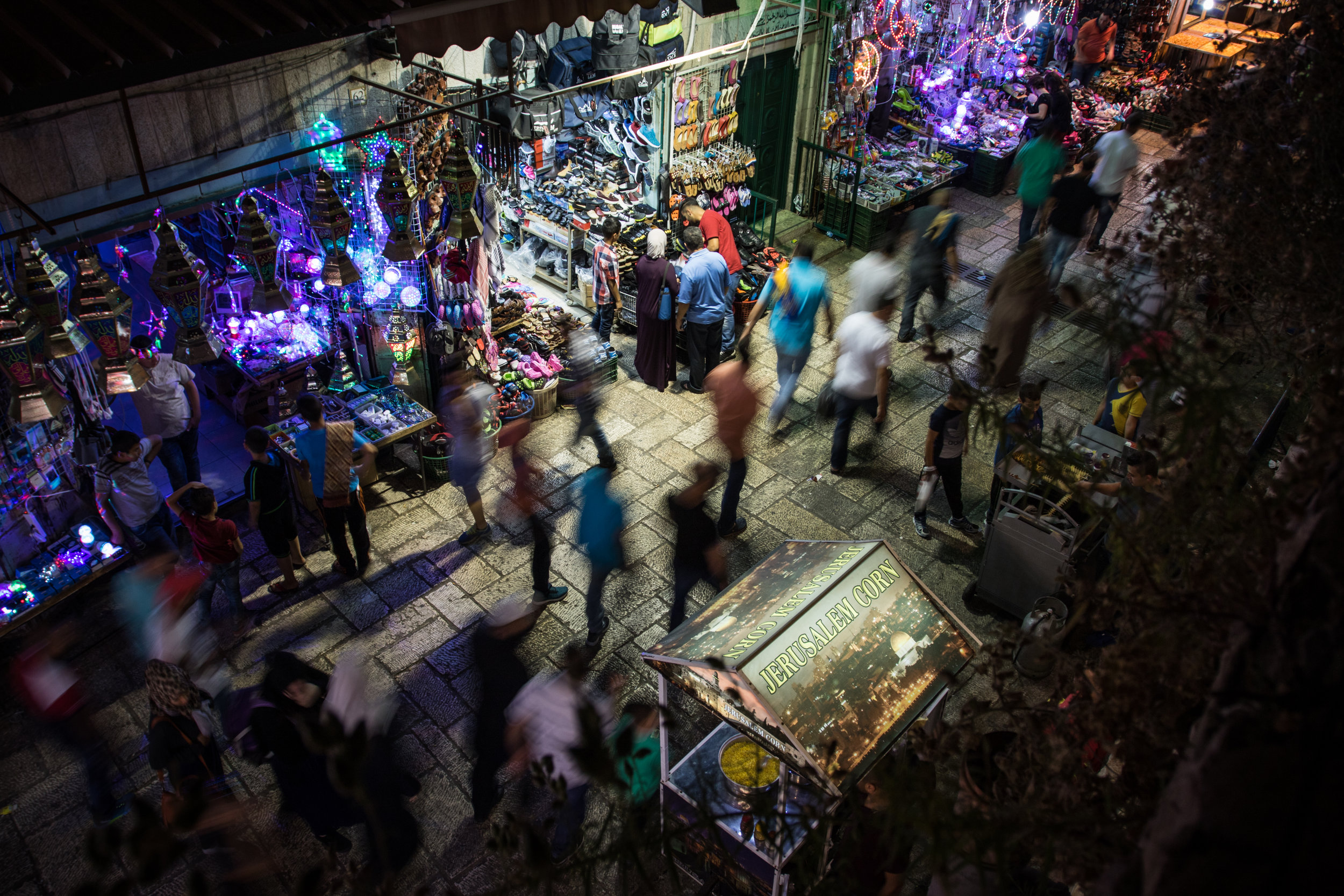 People walk through the streets of the Muslim quarter of the Old City of Jerusalem during the eighth night of Ramadan, June 14, 2016. After Muslim families and friends take Iftar (the meal which breaks the fast) after sundown, many make their way to the Old City to buy fresh food from merchants, meet up with other friends and family and enjoy the festive lights hung to celebrate the holiday. With each passing day of Ramadan, the celebrations become more and more intense, culminating with Eid al-Fitr, the final day of the holy month during which no Muslim is allowed to fast and great banquets are held all across the Muslim world.