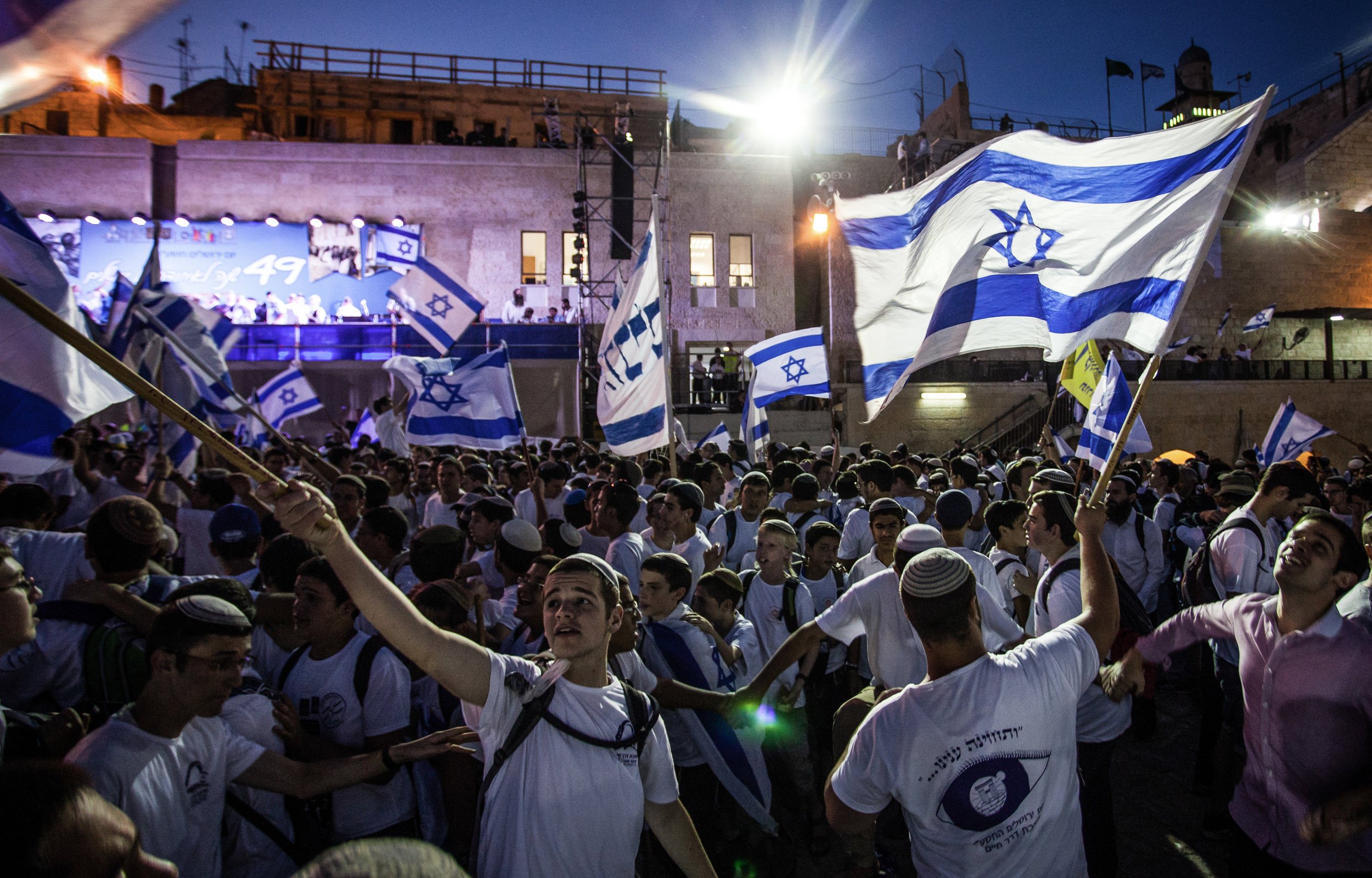 Jewish boys dance and wave Israeli flags near the Western Wall in the Old City of Jerusalem as part of celebrations for Jerusalem Day, June 5, 2016. The holiday signifies the day when Jerusalem was unified with the Israeli state as a result of the Six-Day-War in 1967. This year the holiday happened to fall very close to the beginning of the Muslim holiday of Ramadan, further highlighting the controversial nature of the celebration. Advocates of the day see it as a day of significant triumph for the Israeli state and Jewish culture while opponents view it as a crude display of nationalistic gloating. Even with the controversial date this year, though, there were no significant instances of violence.