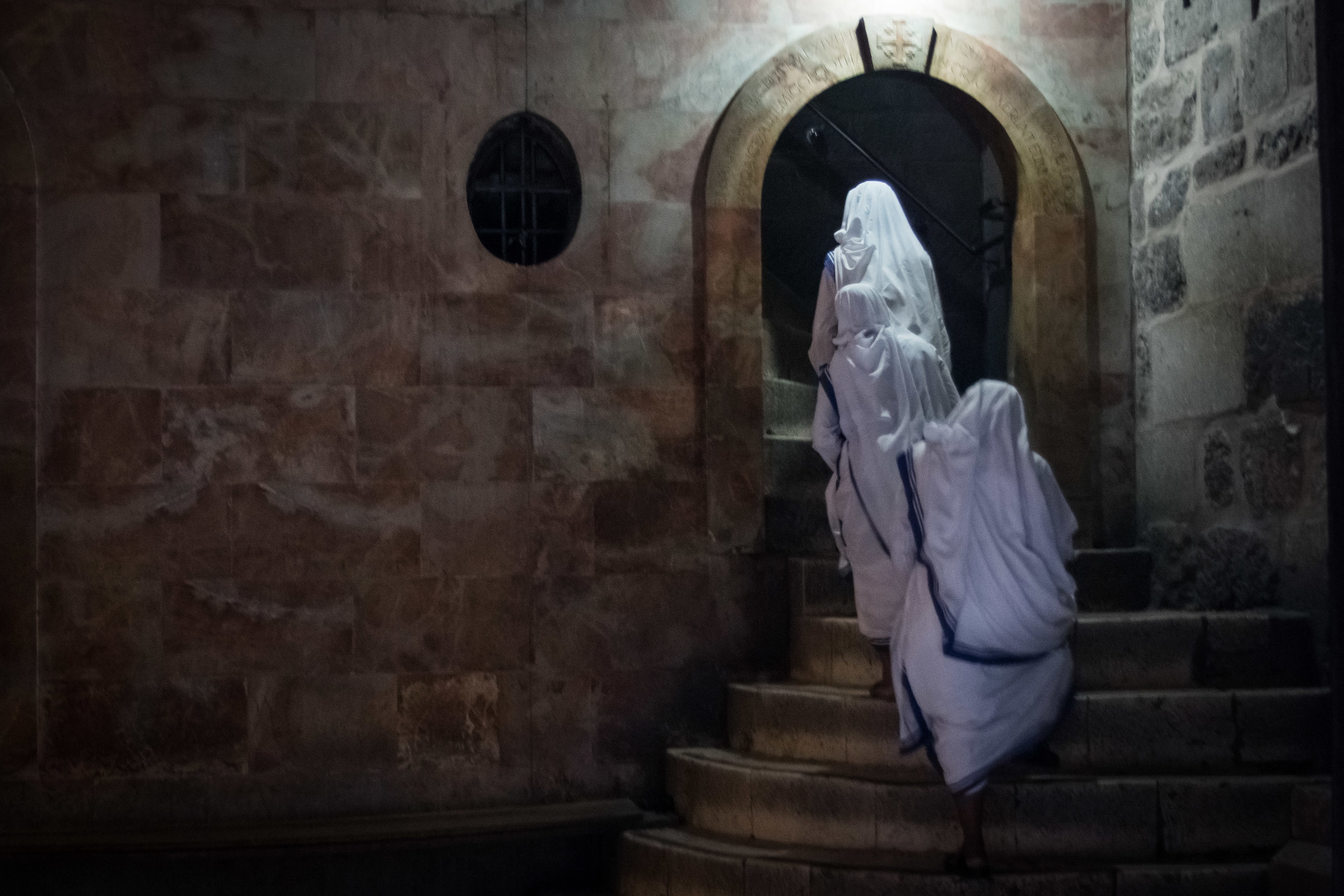 Christian nuns ascend the steps leading to Calvary inside the Holy Church of the Sepulchre in the Old City of Jerusalem, July 28, 2016. The shrine is where Jesus was said to have been crucified before being embalmed at buried in his tomb nearby.