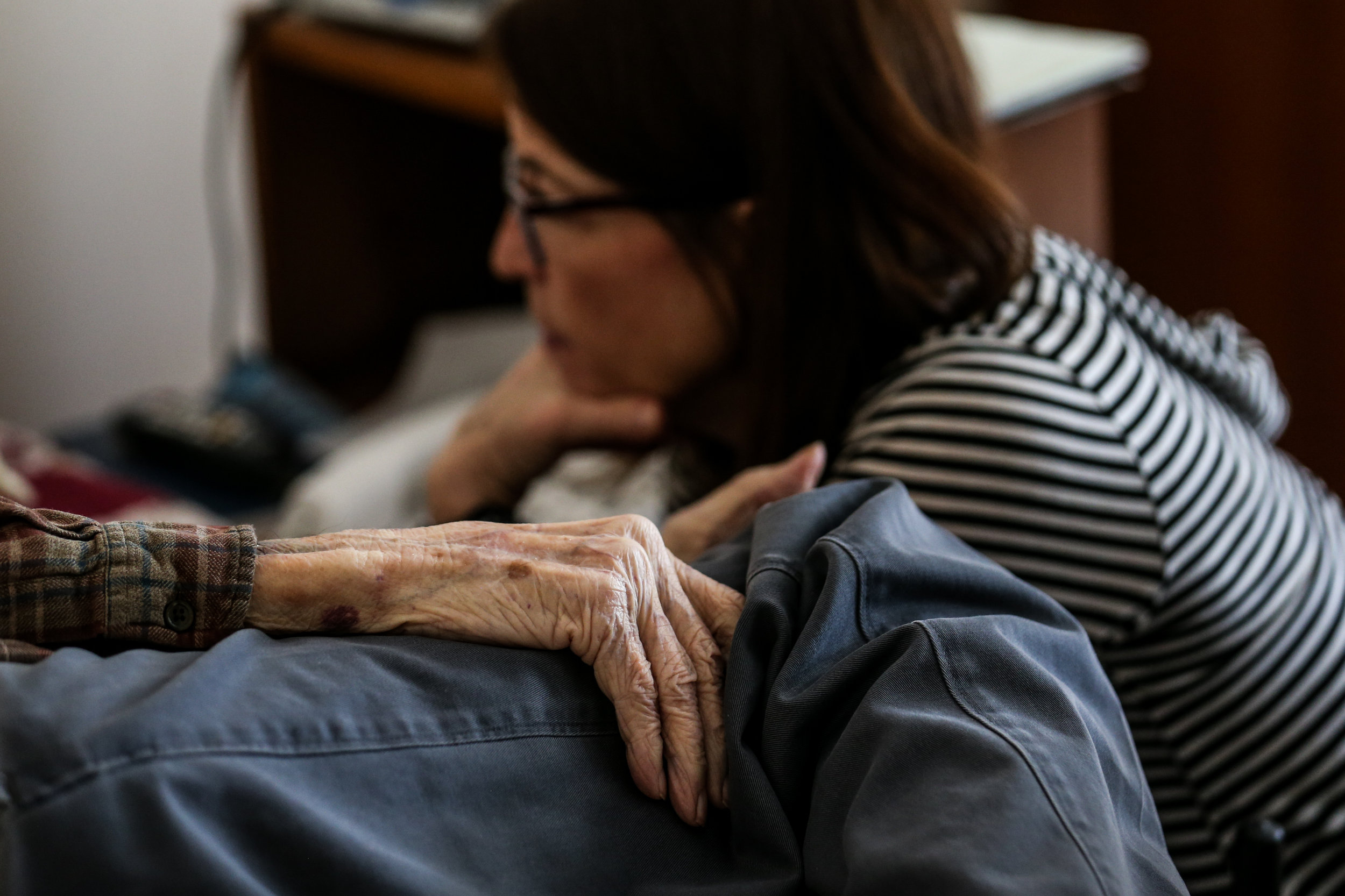 Lee Read talks with a new patient to find out what condition his health is in at the RoseWood Village assisted living home at Hollymead Town Center.
