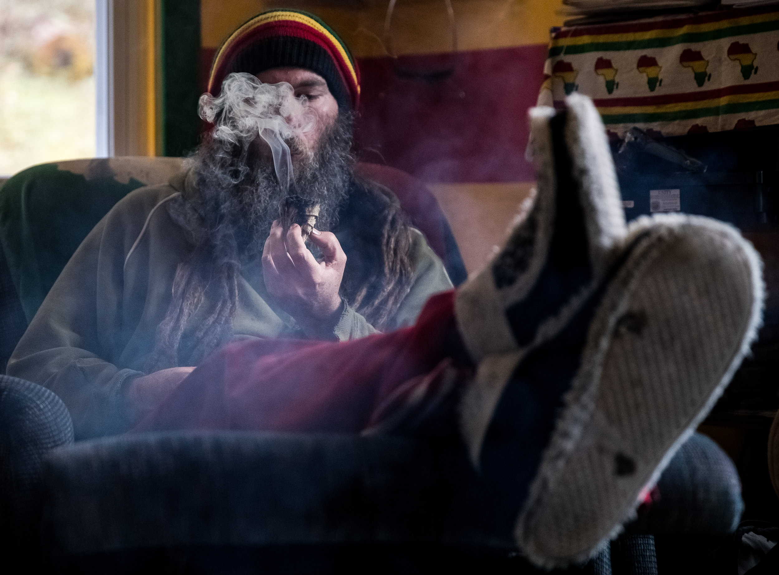 Ed Skopal lives with his family in rural Floyd, Virginia on a four-acre plot of land not far from where he attended school at Virginia Tech. Ed is a Rastafarian and a medicinal herb farmer, using some of the core tenants of the ideology (veganism, homeopathic remedies, generosity and love) to create medicinal products that he sells with his wife Maya at local farmers markets.  After being falsely accused of molestation in middle school, putting a child up for adoption just before college and becoming morbidly obese, he was primed to make drastic changes in his life with the help of some key professors at the university. He entered into Virginia Tech's graduate school in the department of sociology and wrote a dissertation on the economic effects Reggae music had on the Jamaican economy. The research trips he made to Jamaica ultimately led to his desire to take the Vow of the Nazarite, fully converting himself to Rastafarianism.  With his life and identity rebuilt, the home he now shares with his three children (Adaijah, Jahzara, and Irijah) is a reflection of the happiness that a commitment to love, health and freedom has brought him and his family.