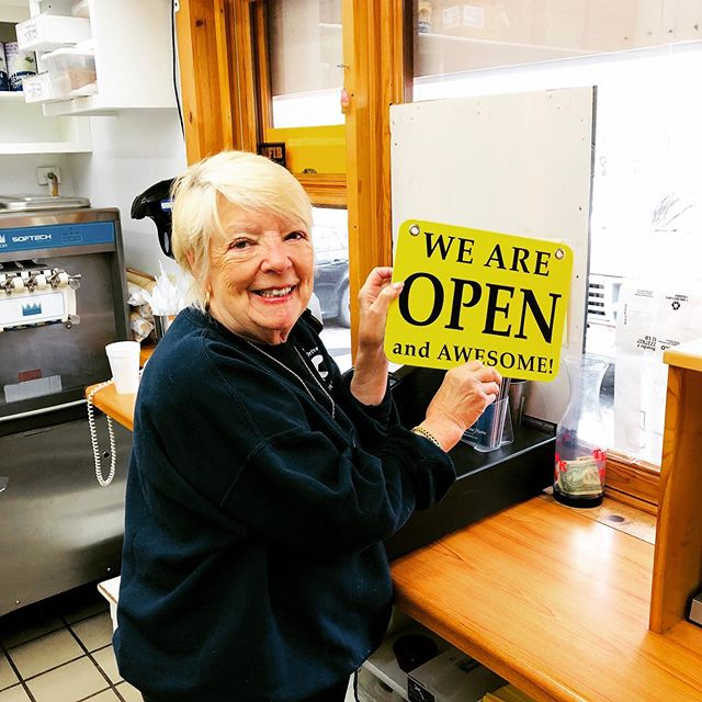 Owner, Patricia, turning the open sign for our 43rd season!  We are open Memorial Day weekend Friday-Monday 11-5pm. 🎉😃🍔