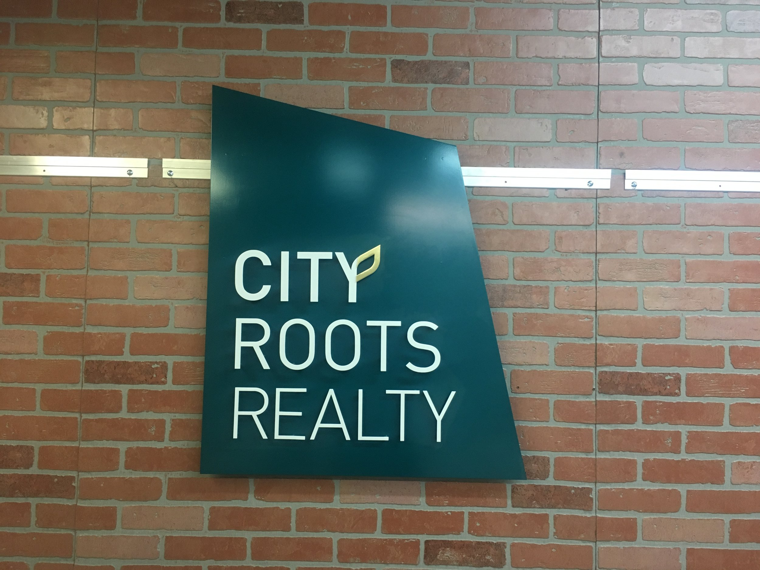 Custom Metal Sign- City Roots Realty- Front.JPG