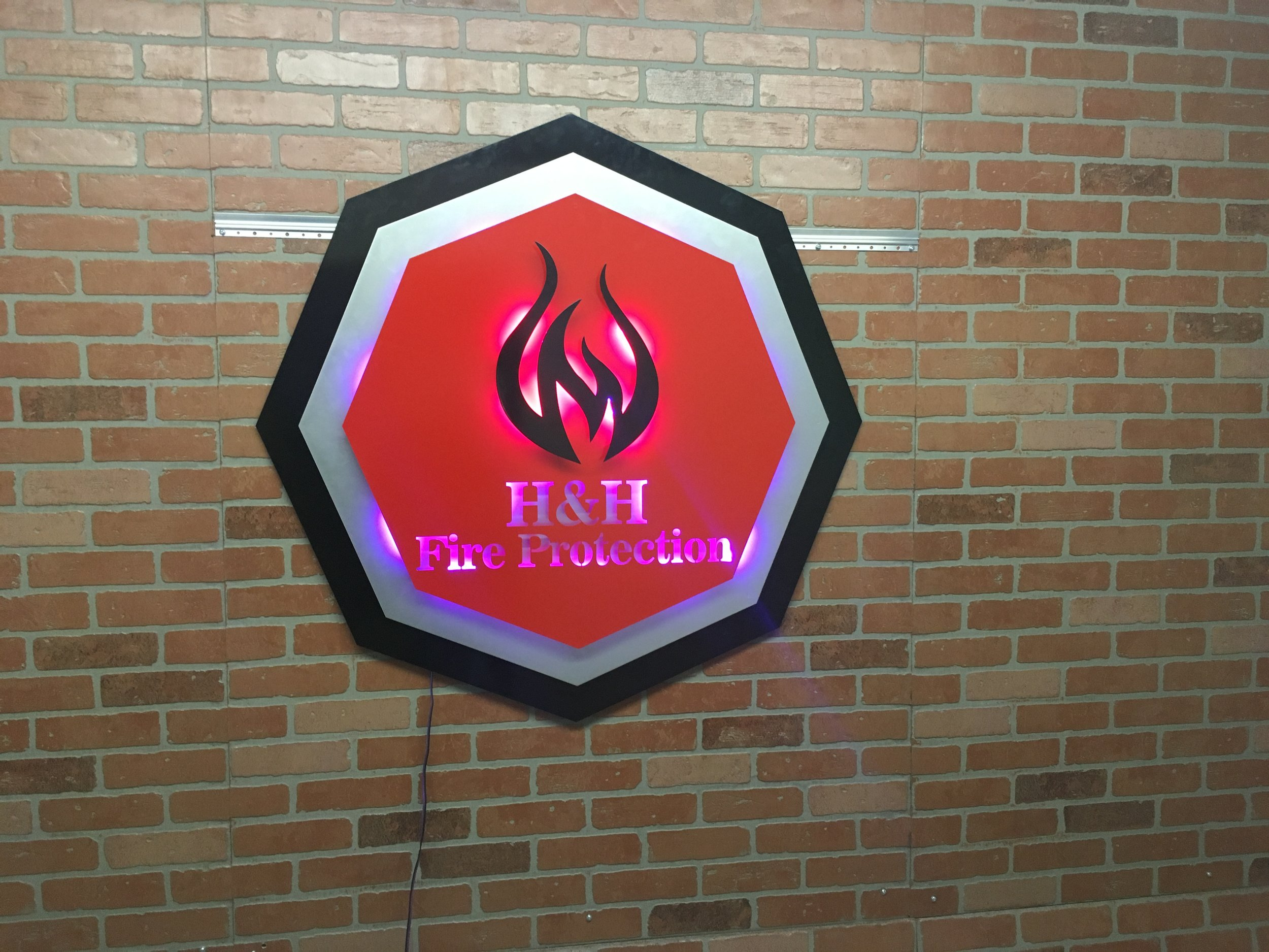 Custom Metal Sign-H&H Fire Protection-left.JPG