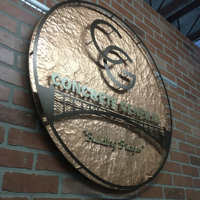Low angle view of the hammered copper sign