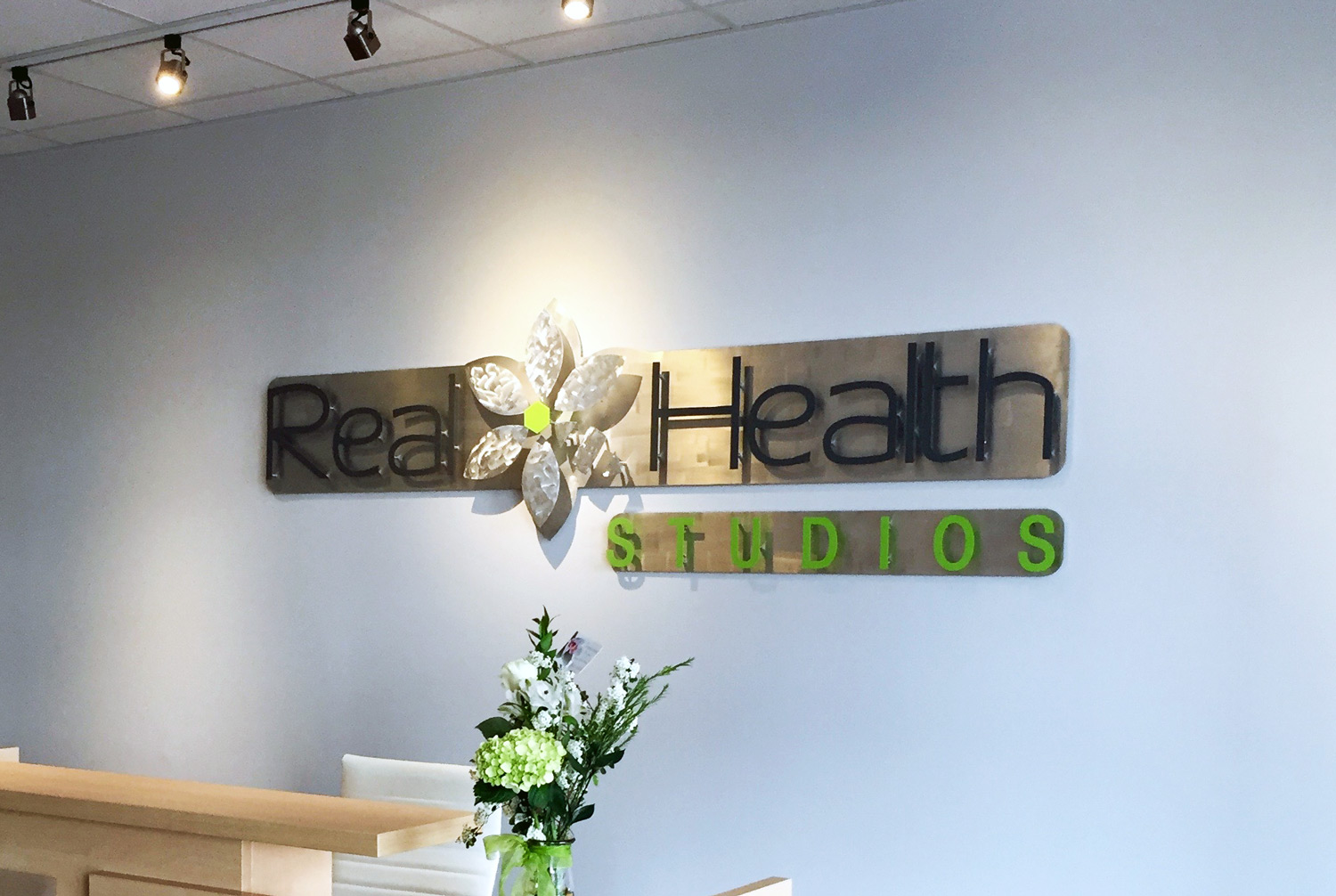 Entryway Sign  Real Health Studios