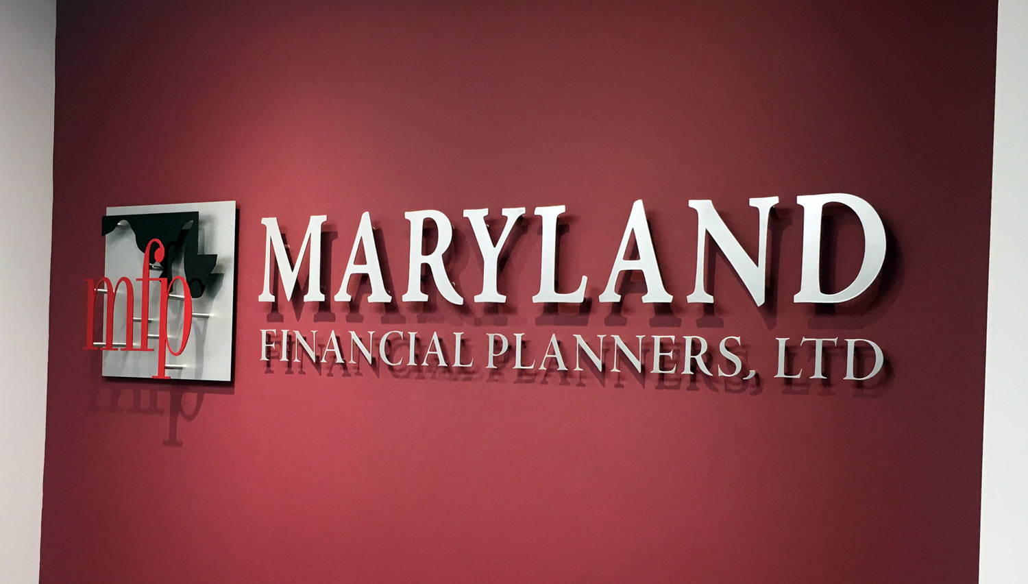 Custom-Metal-Sign-Maryland-Financial-Planners-Logo-and-Individual-Letters.jpg