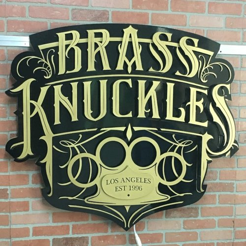 Brass Knuckles Sign Without the Lights On