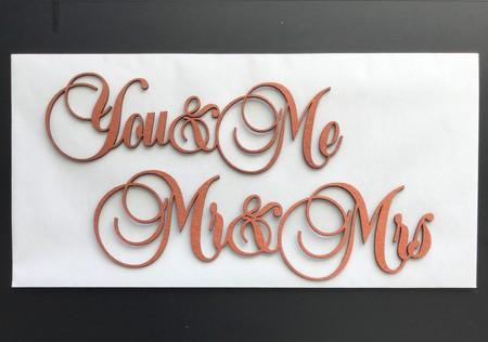 laser cut cursive lettering out of copper.jpeg