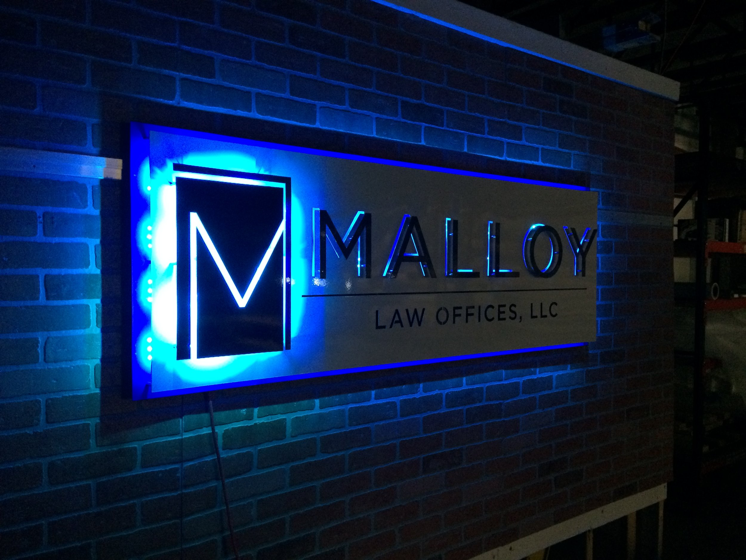 Custom Metal Sign- Malloy Law- Left-lights off.JPG