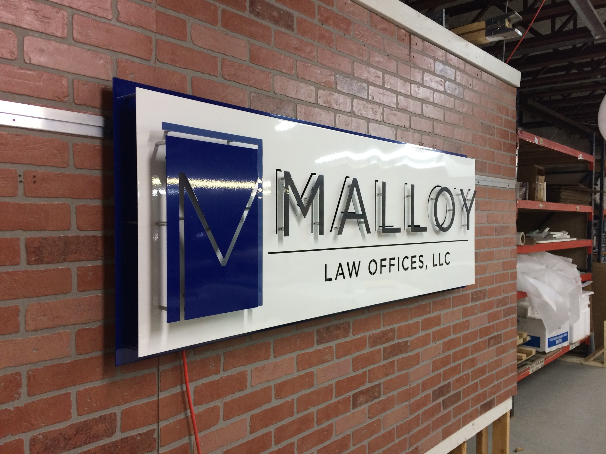 Custom Metal Sign- Malloy Law- Left.JPG