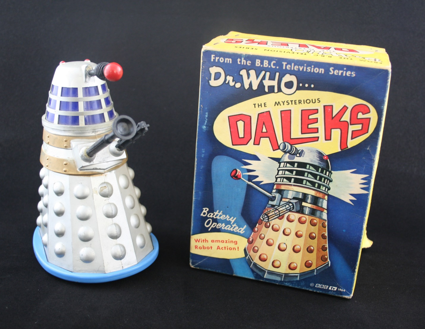 Louis Marx & Co. Ltd. First version of the battery-operated Dalek with body spray-painted silver and blue base.