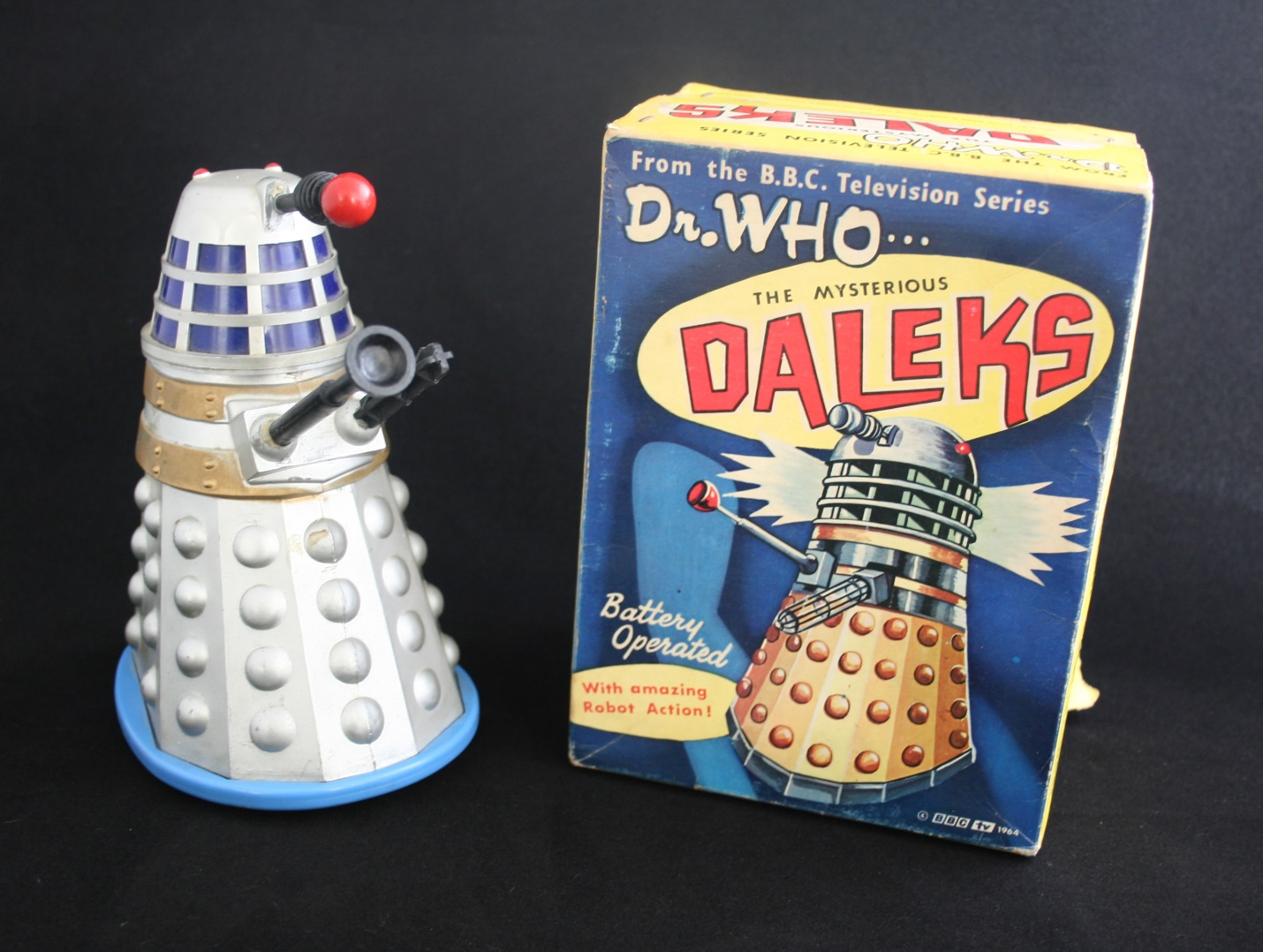Louis Marx and Company Ltd., The Mysterious Daleks, a battery-operated toy with amazing robot action (second version with solid grey plastic body and blue base in first version of box).