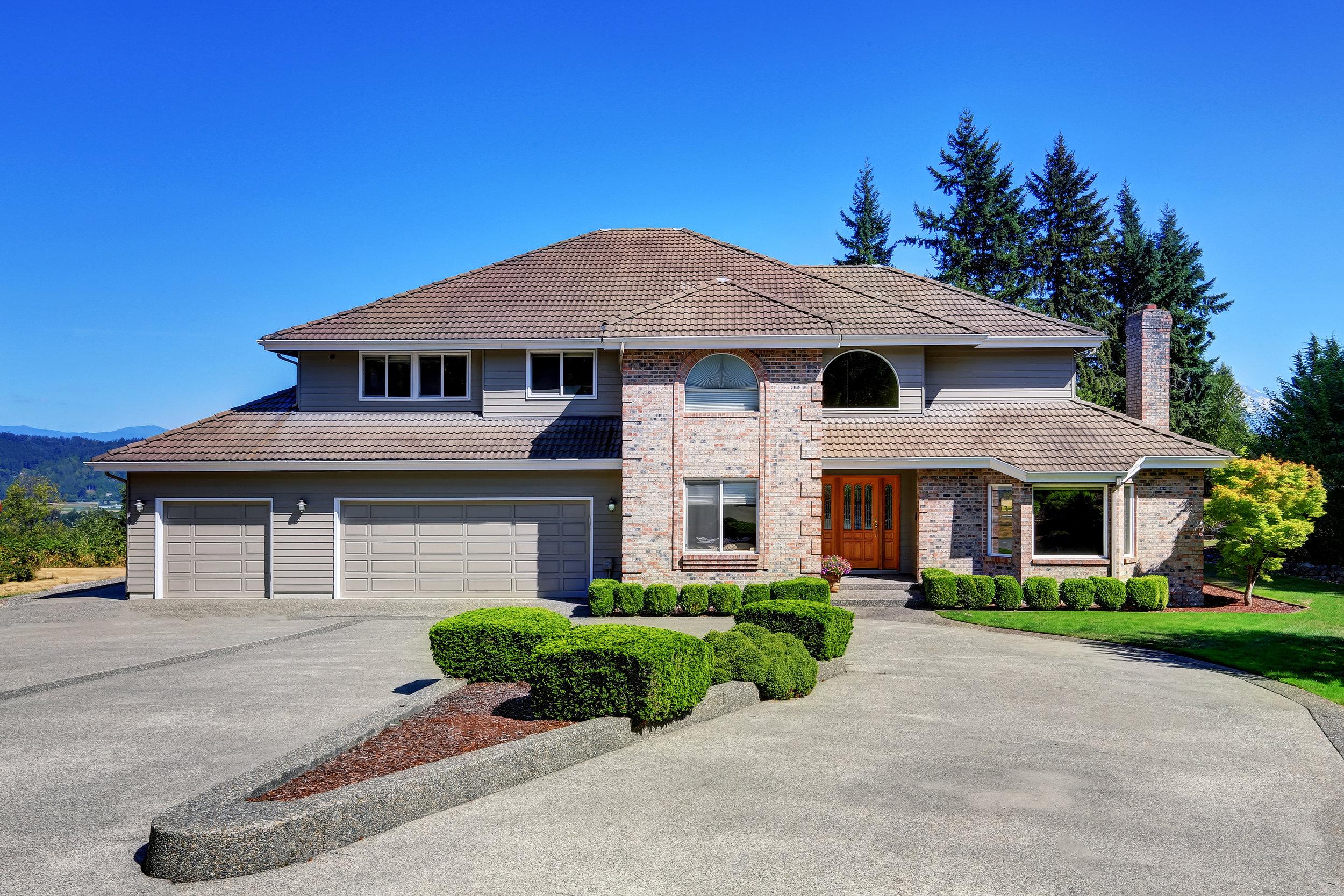 bigstock-Luxury-Brick-House-With-Beauti-144030671.jpg