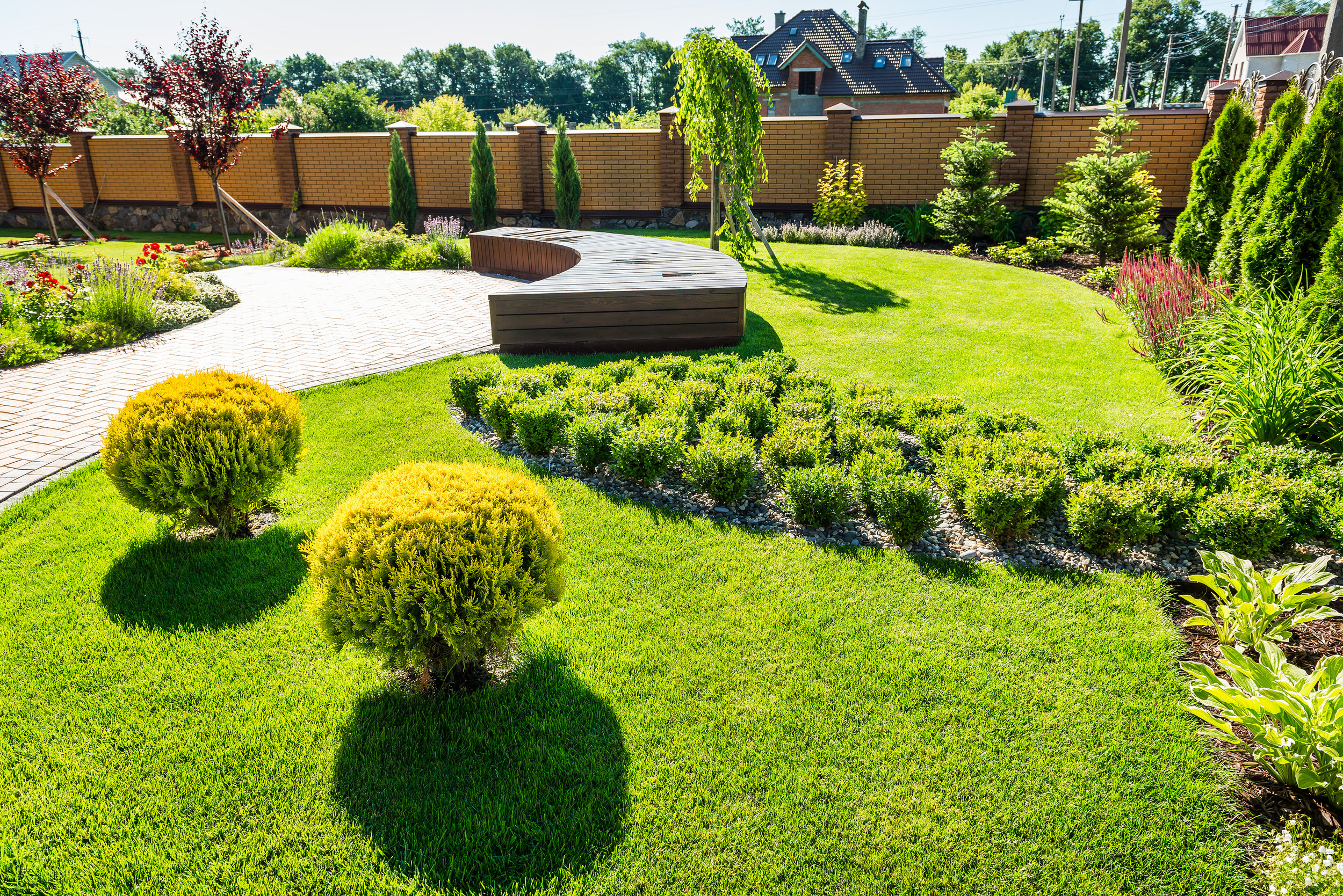bigstock-Beautiful-Landscaping-With-Bea-185709037.jpg