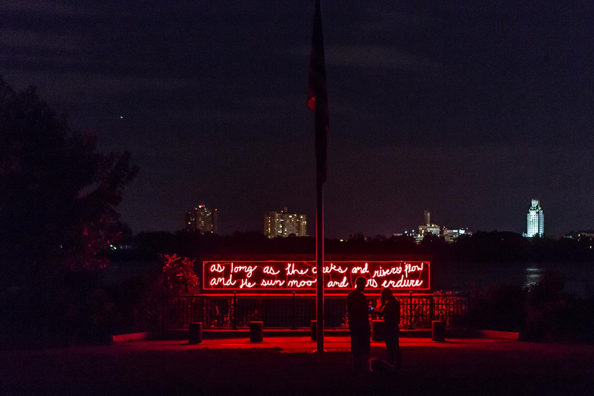In Perpetuity  Duane Linklater Born in 1976 • Omaskeko Ininiwak/Moose Cree First Nation • Based in North Bay, Ontario Neon, transformers, aluminum, polycarbonate, and handwritten text by Sassa Linklater Penn Treaty Park   Photo: Steve Weinik/Mural Arts Philadelphia