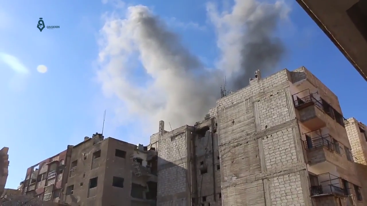 Smoke rises from a building in the Damascus suburb of Jobar after being hit by a hit by a bomb during the Qaboun offensive (February–March 2017). (Qasioun News Agency  (CC BY 3.0) )