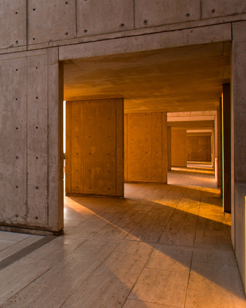 The Salk buildings are offer masterful plays on light, drawing sunshine to even the deepest corners. (Photo via  The LA Times )